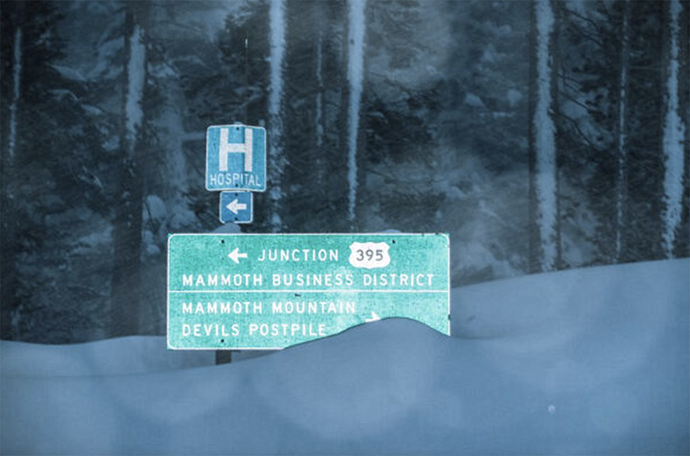 Mammoth street sign covered in snow