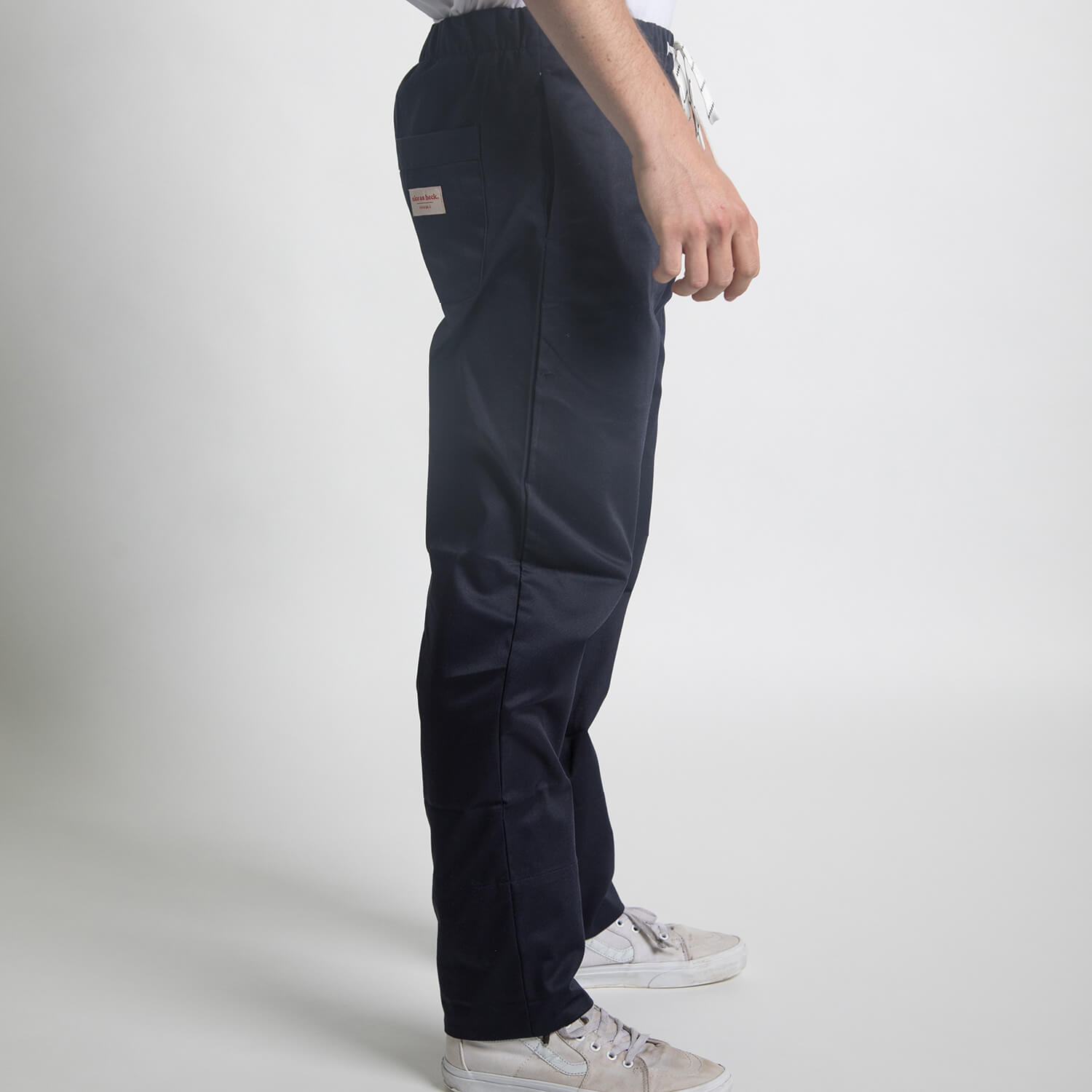 boy wearing utility pants
