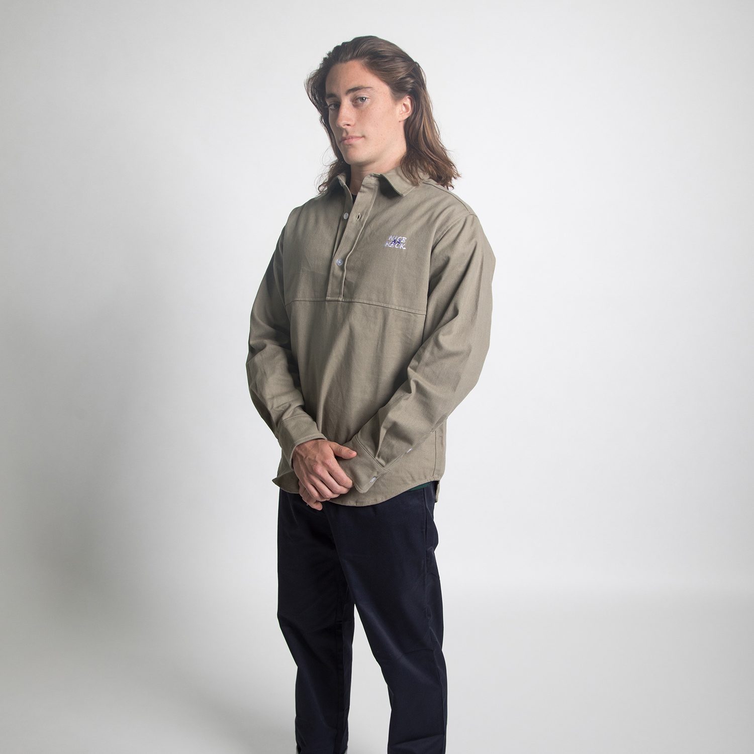 boy wearing down and dirty workshirt