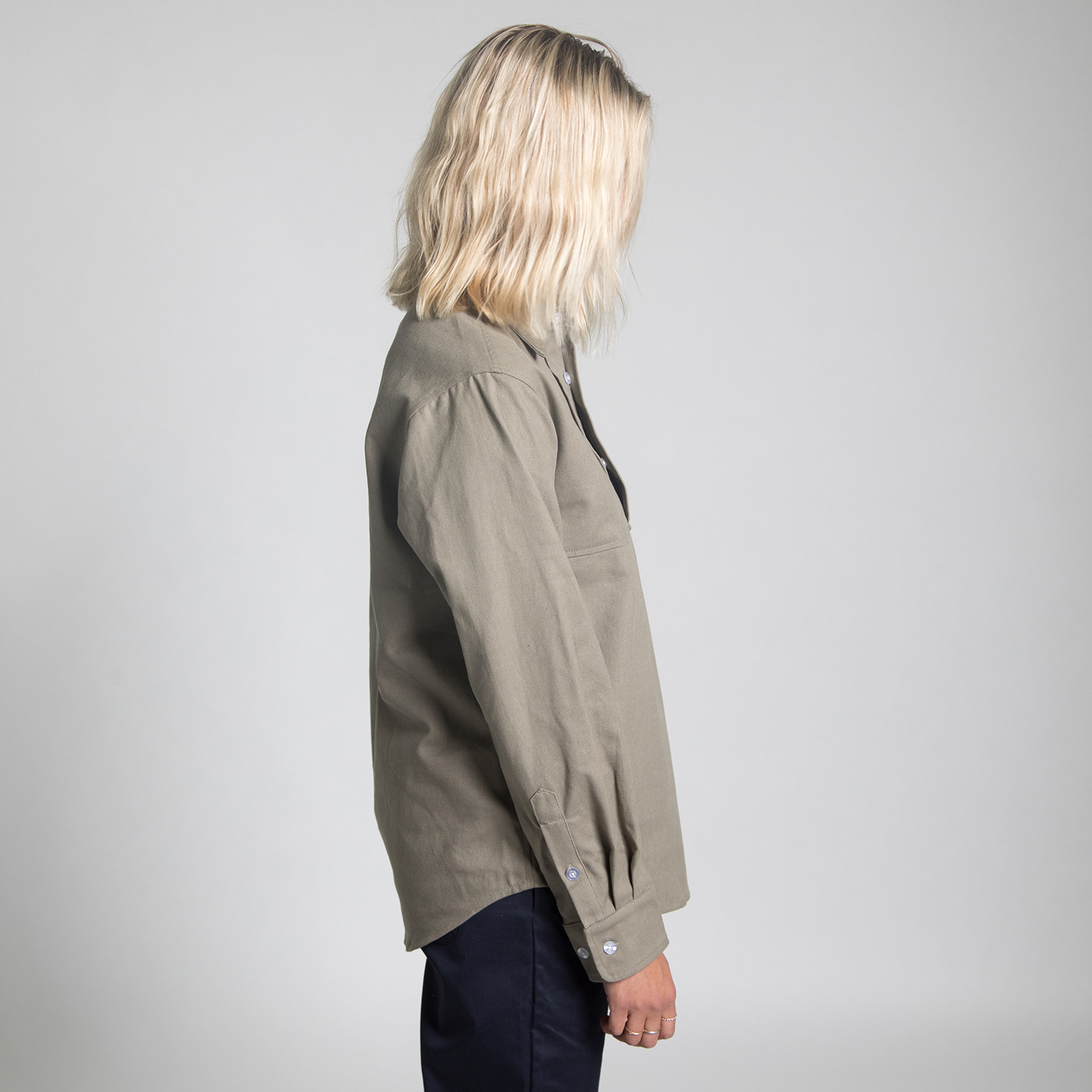 girl wearing down and dirty workshirt