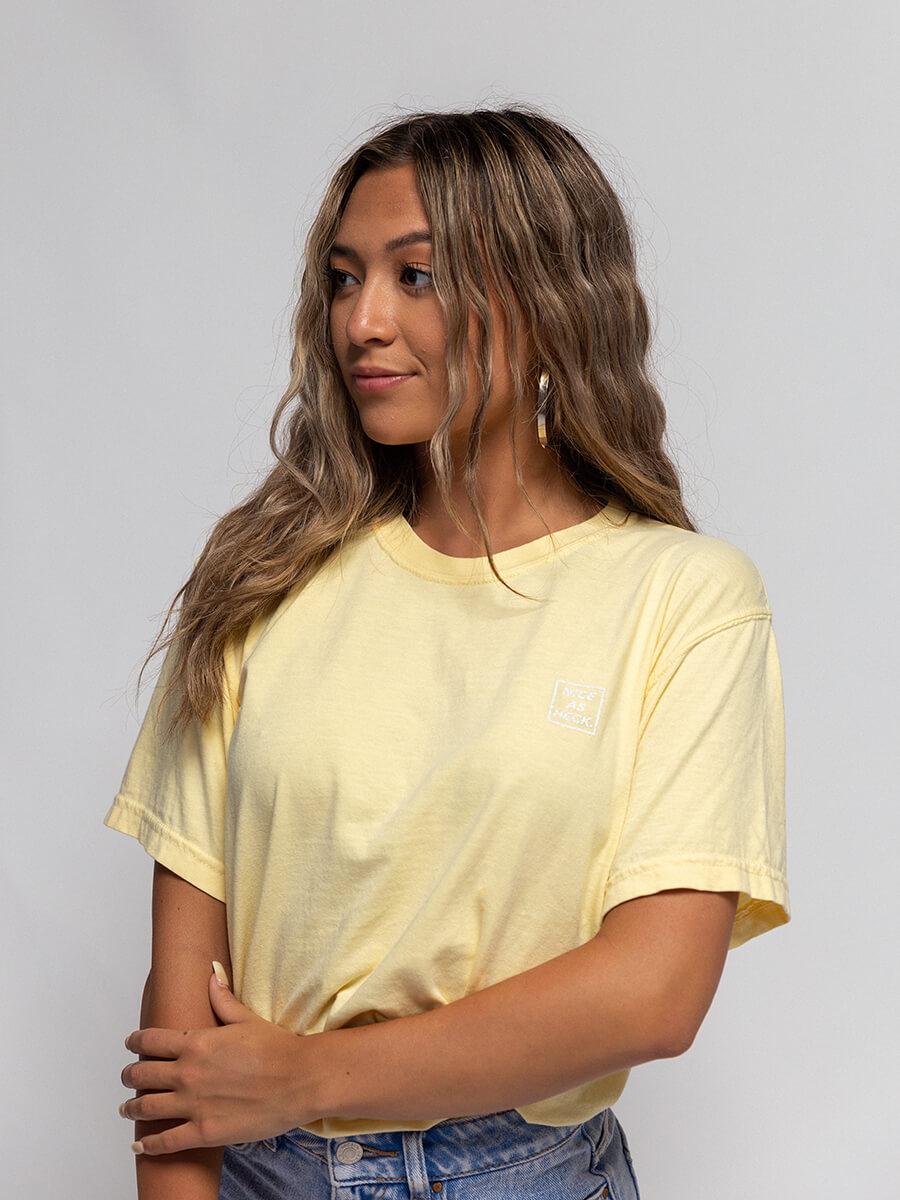 girl wearing mellow yellow tee