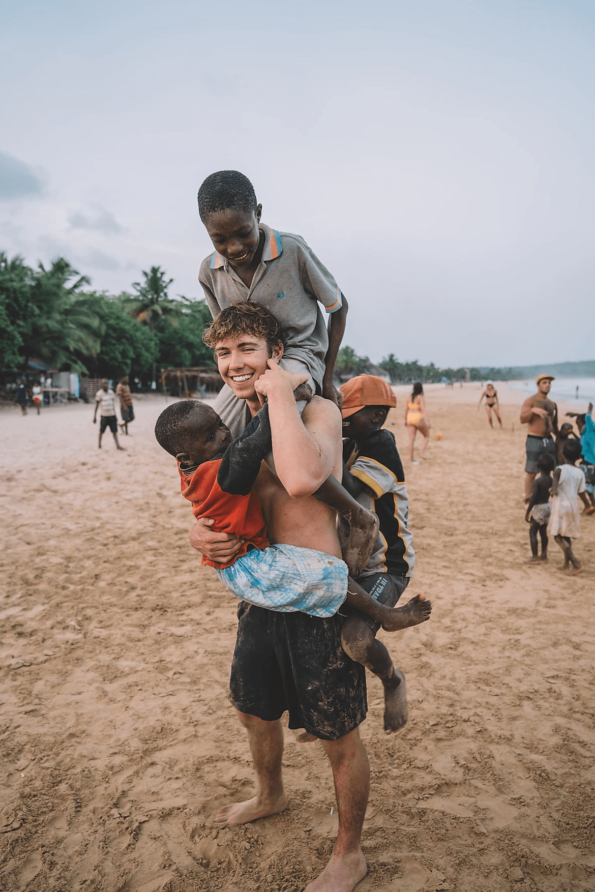 boys on cam's shoulder in ghana