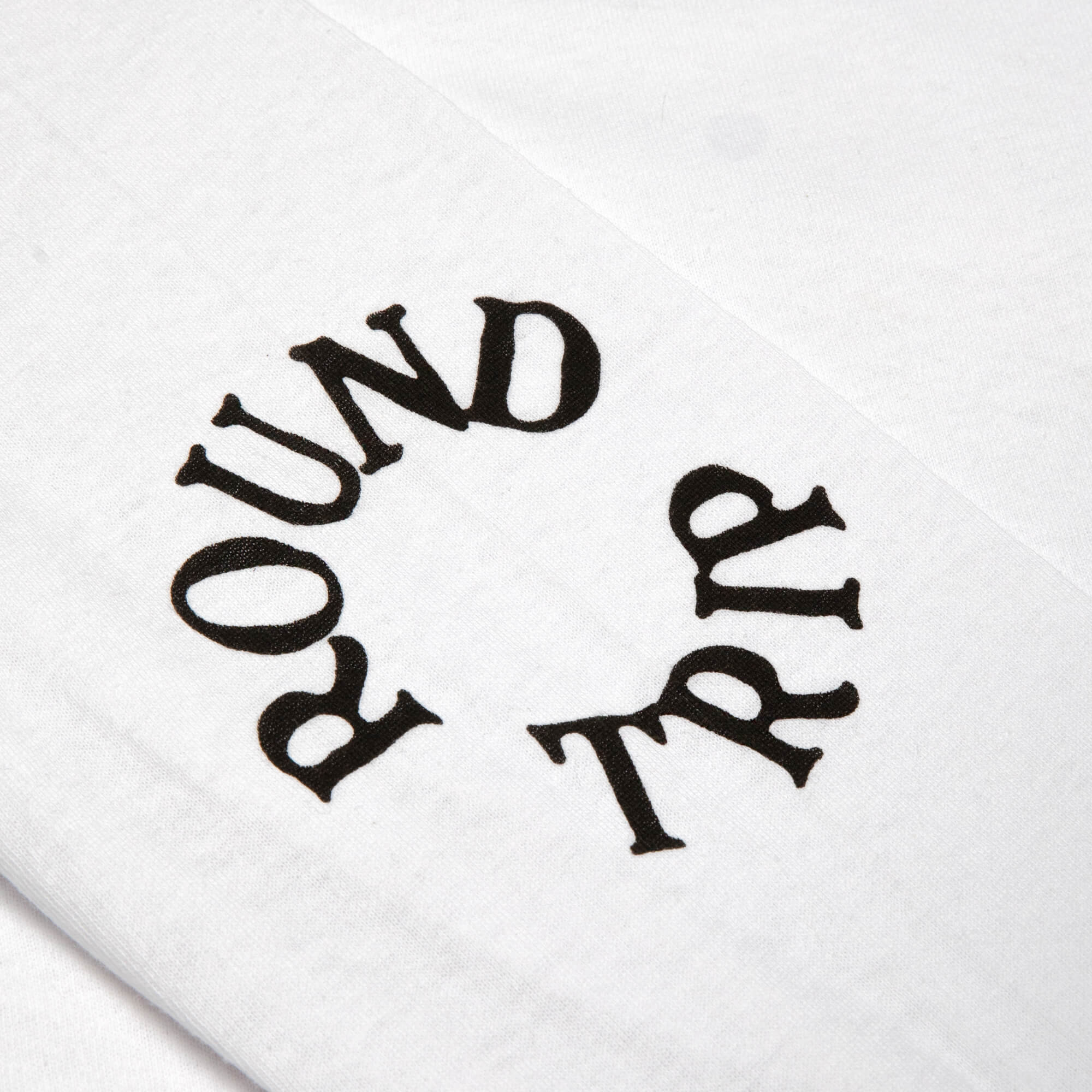 round trip longsleeve logo on elbow
