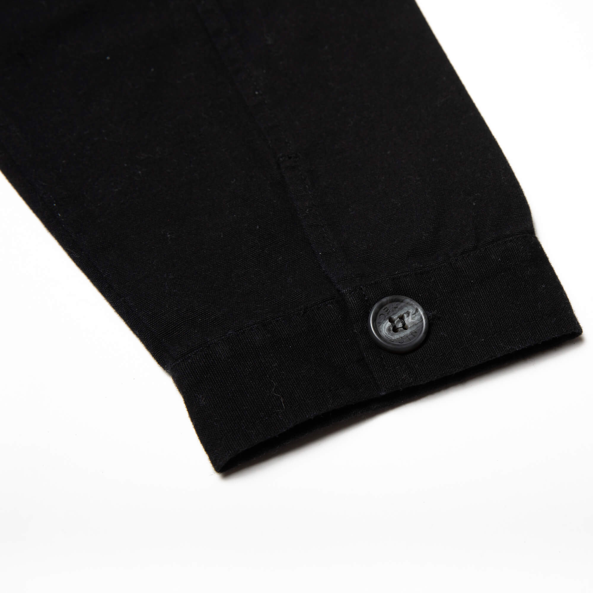 close up of the button up sleeve on the black kickback jacket