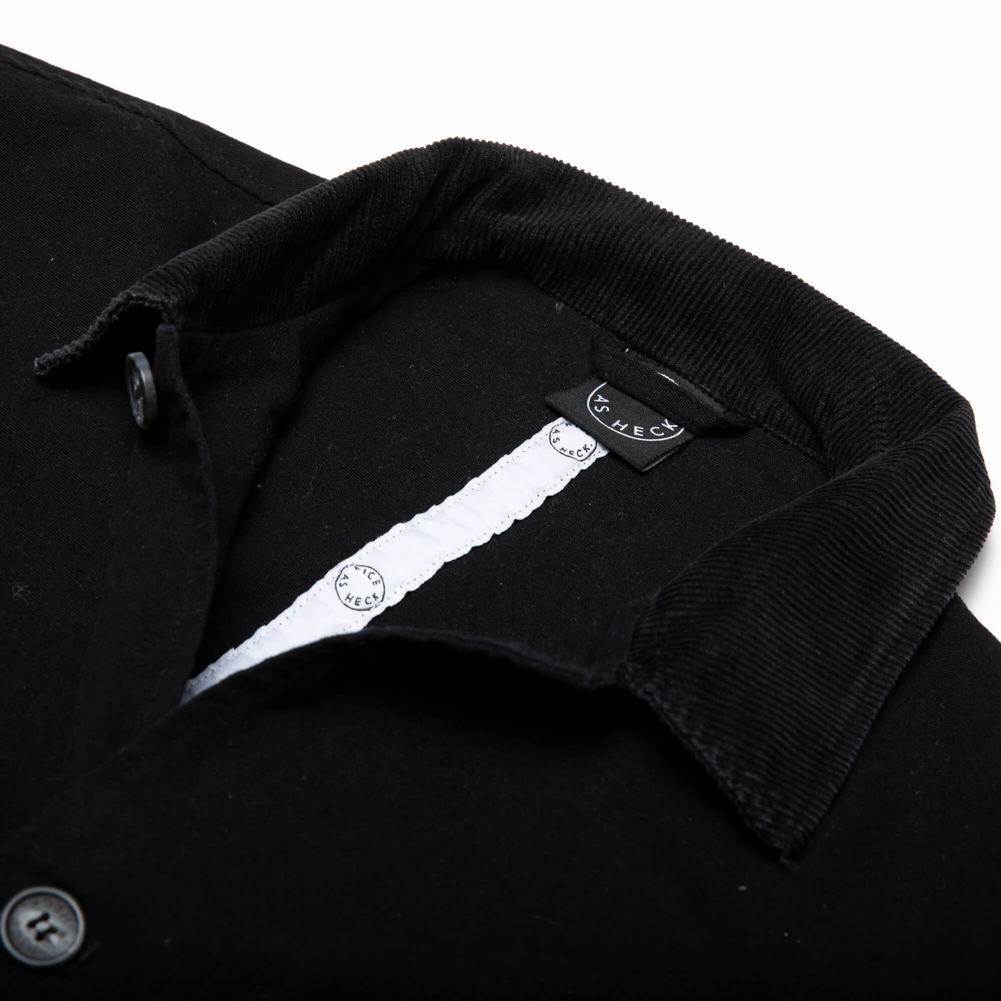 close up of the folded collar of the black kickback jacket