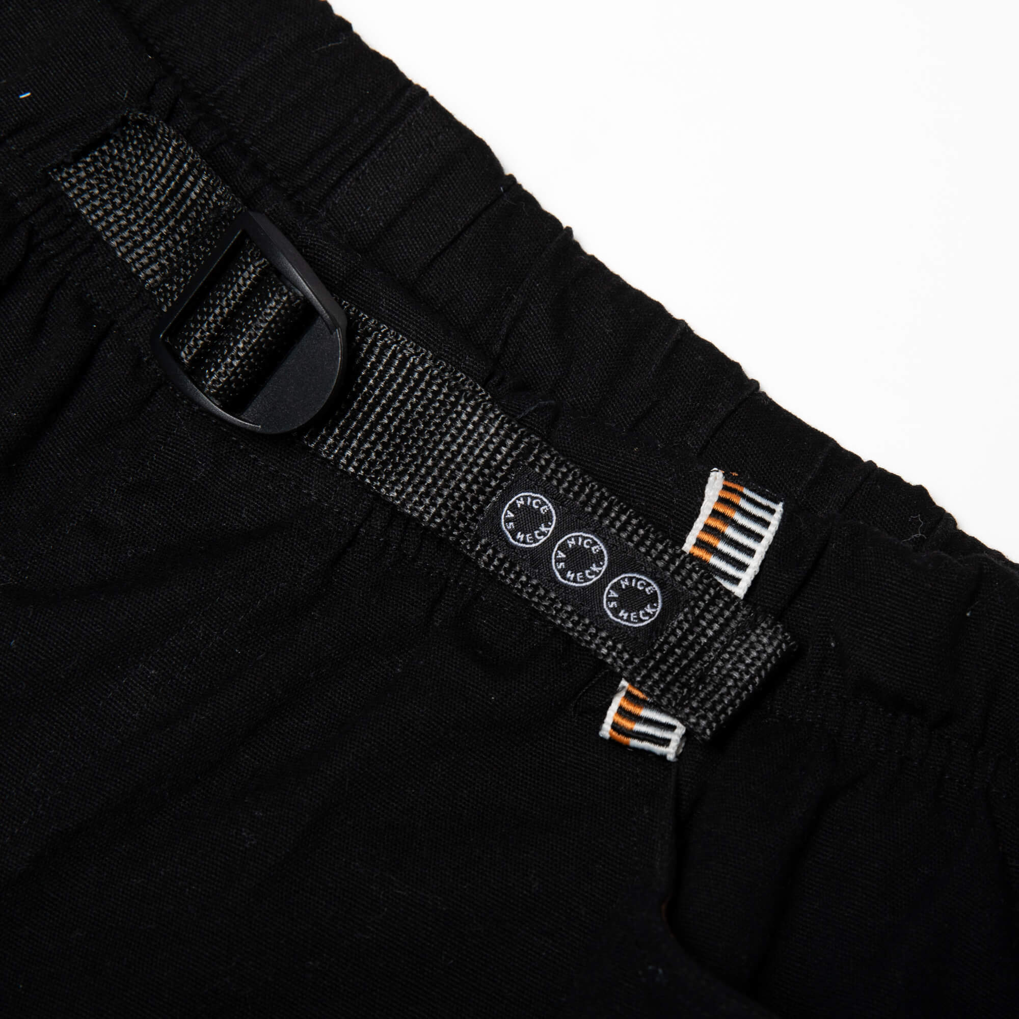 close up view of the adjustable waist of the black wood worker pants