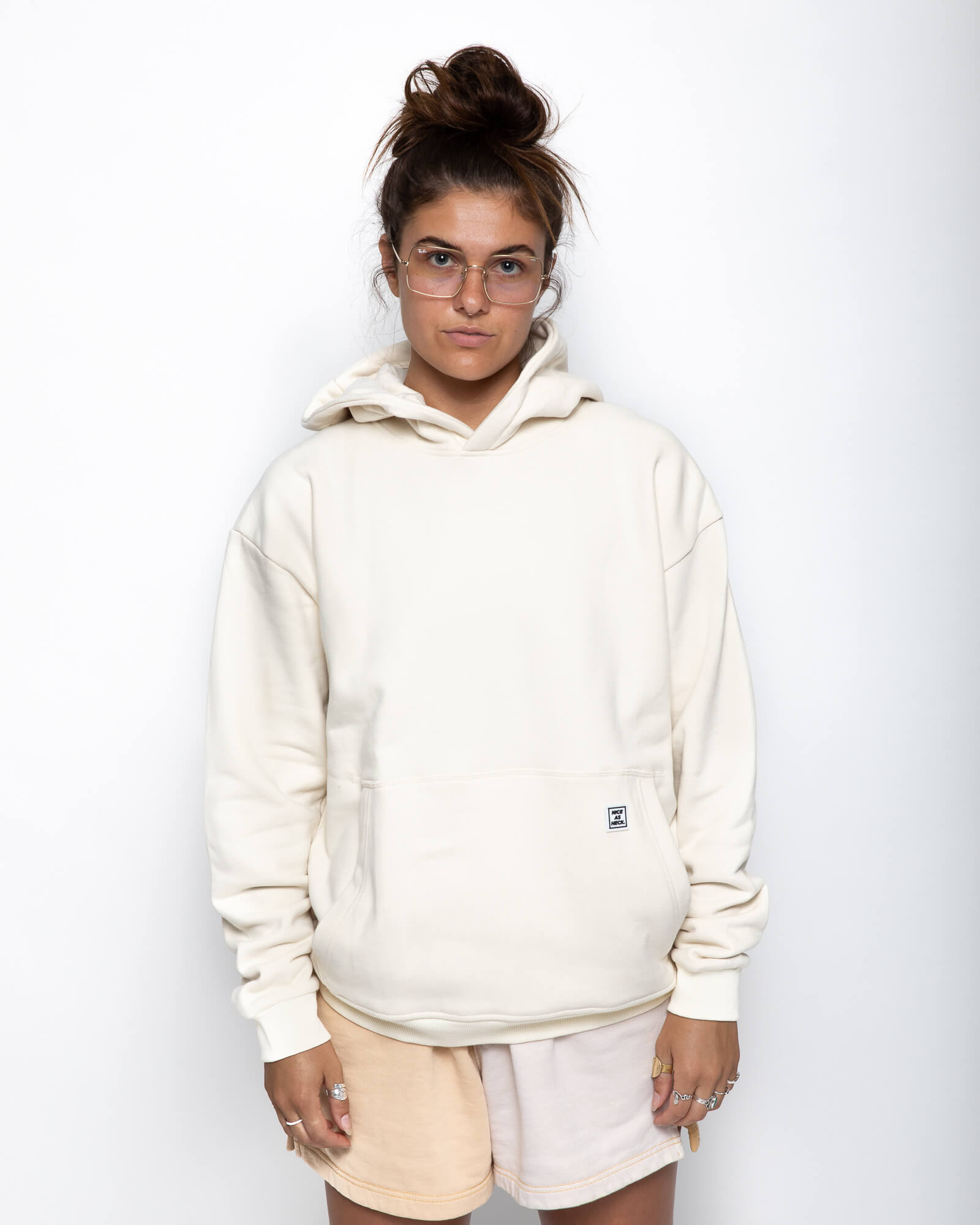 front view of a female model wearing the beige goin steady hoodie