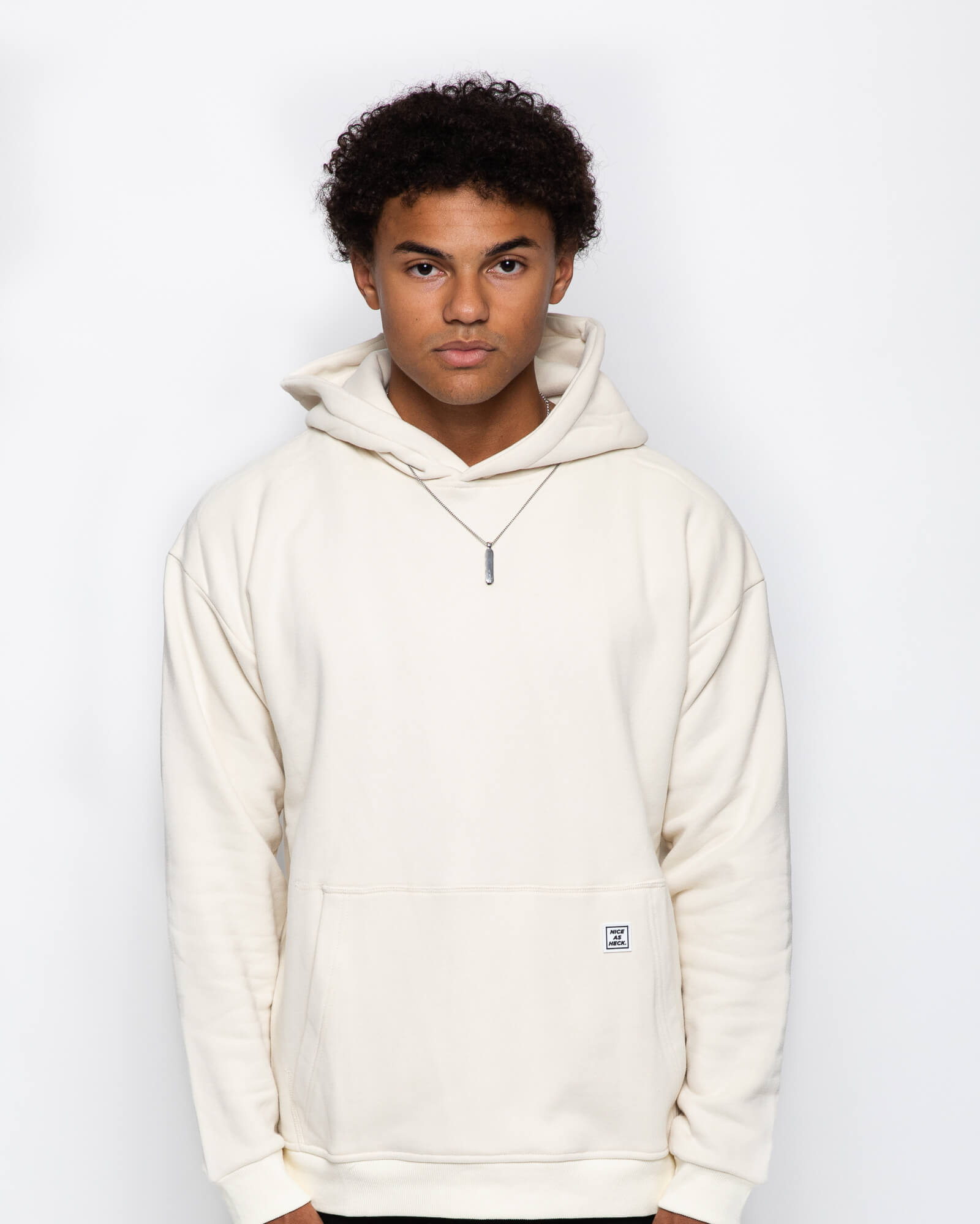 front view of a male model wearing a beige goin steady hoodie