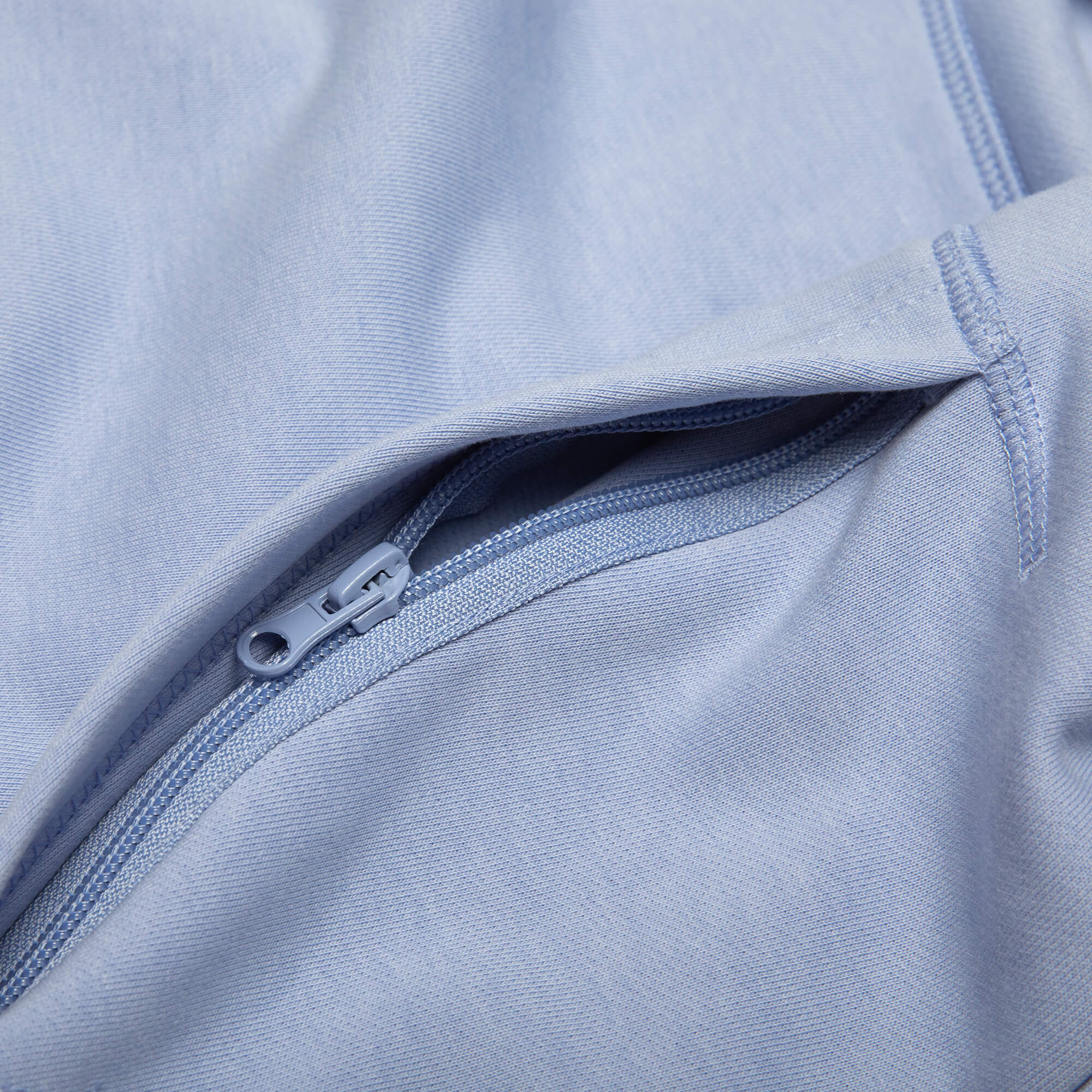 close up of the zipper pocket for the purple goin steady hoodie