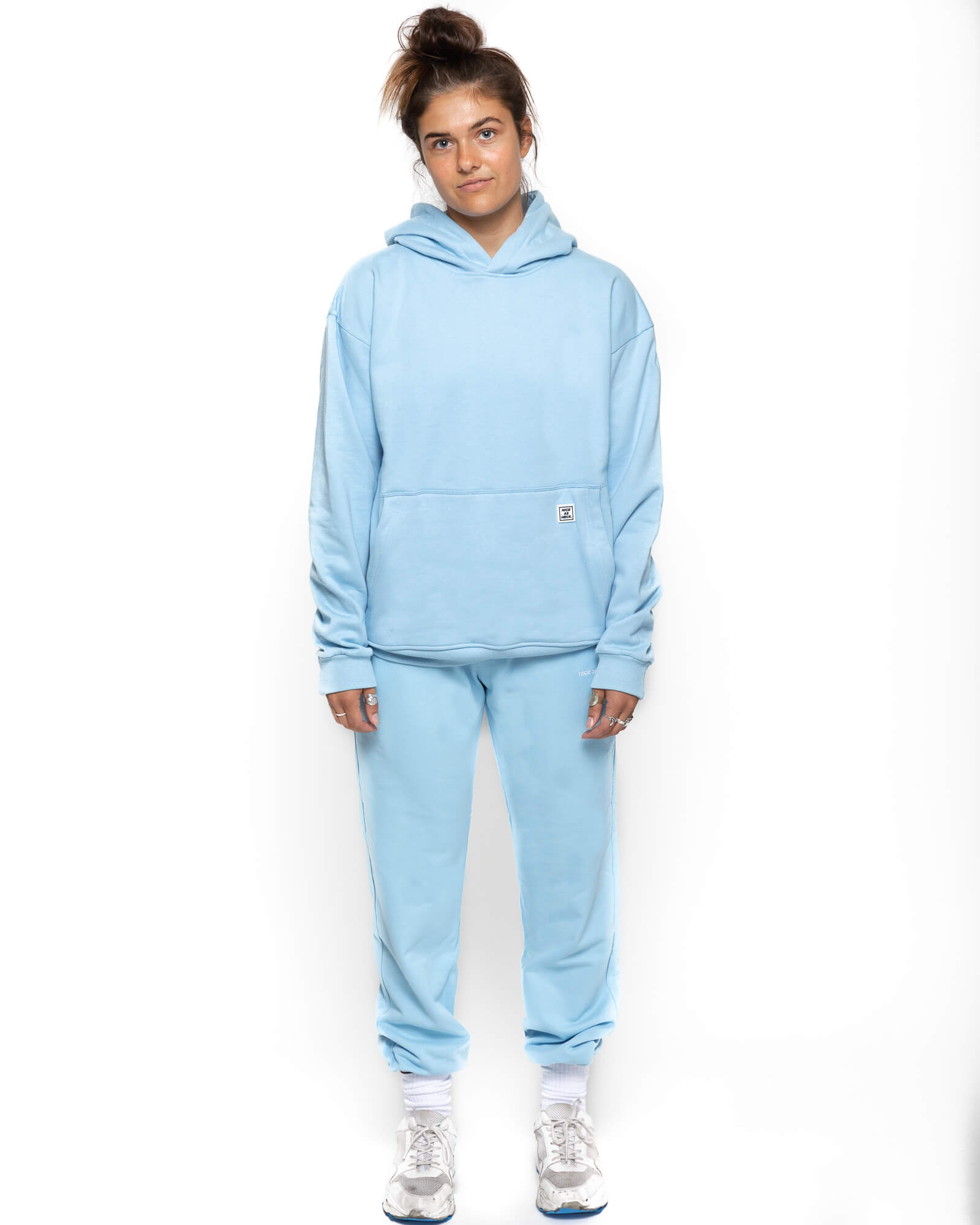 front view of a female model wearing the blue goin steady hoodie with the blue sunday sweats