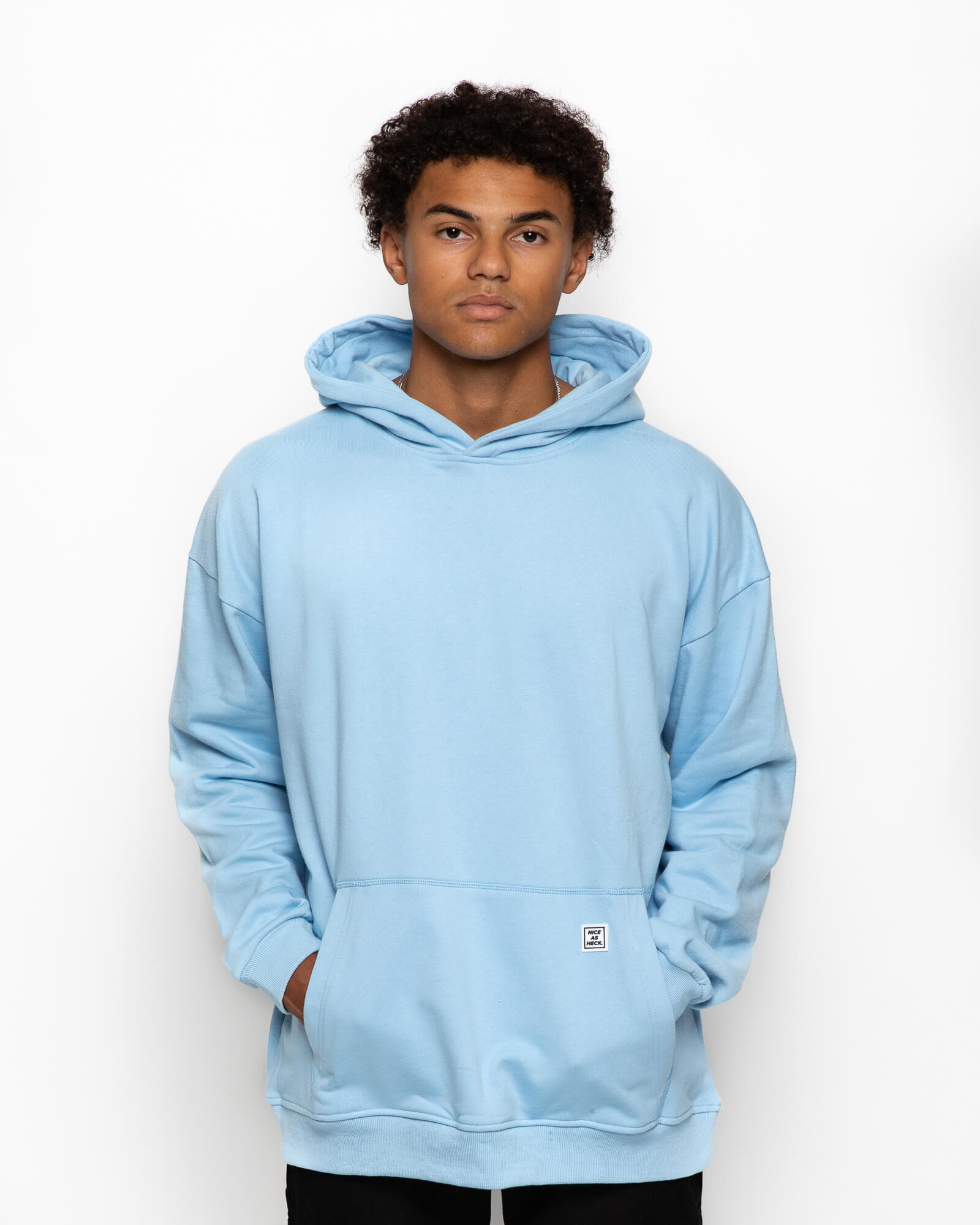 front view of a male model wearing the blue goin steady hoodie with black pants