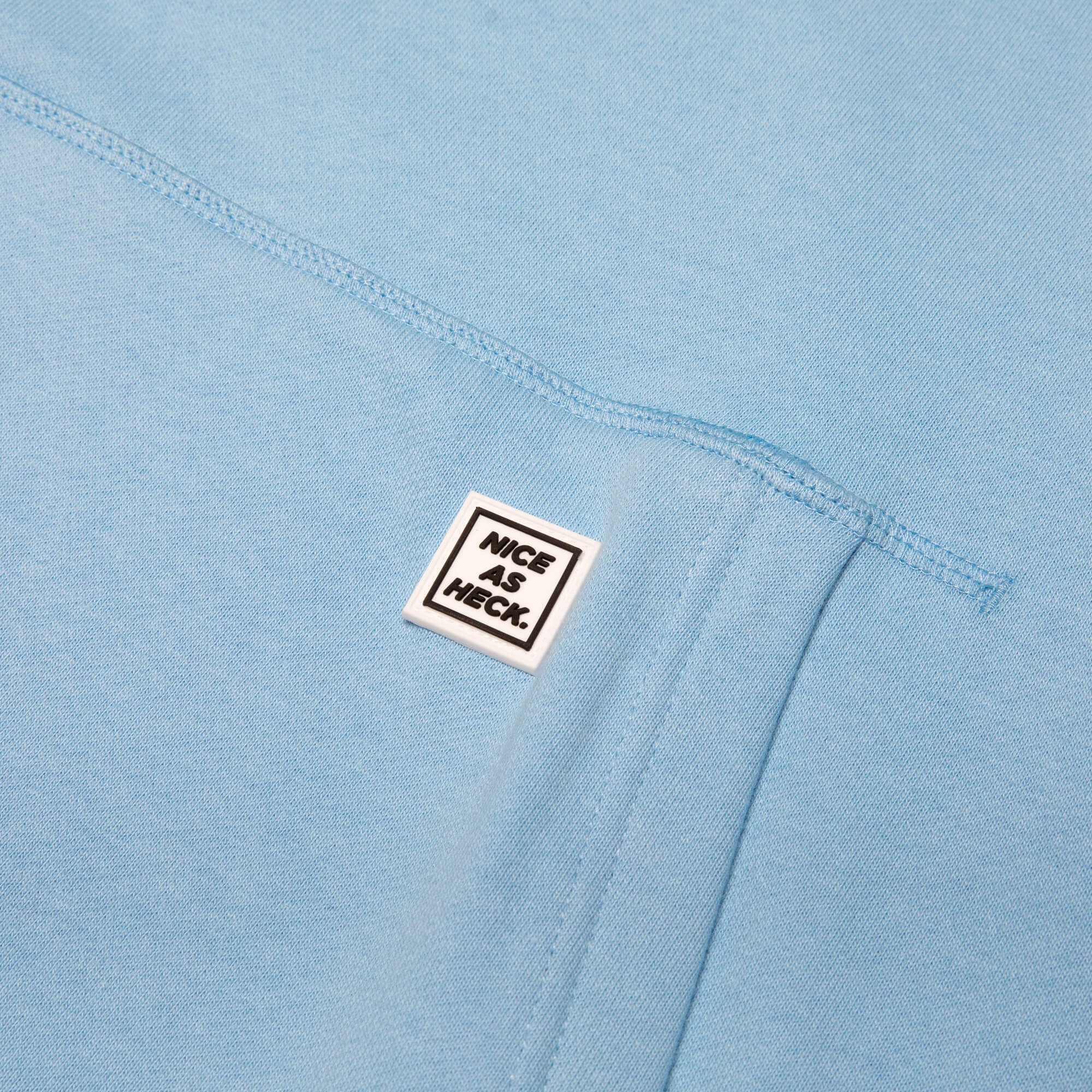 close up of the nice as heck logo on the blue goin steady hoodie