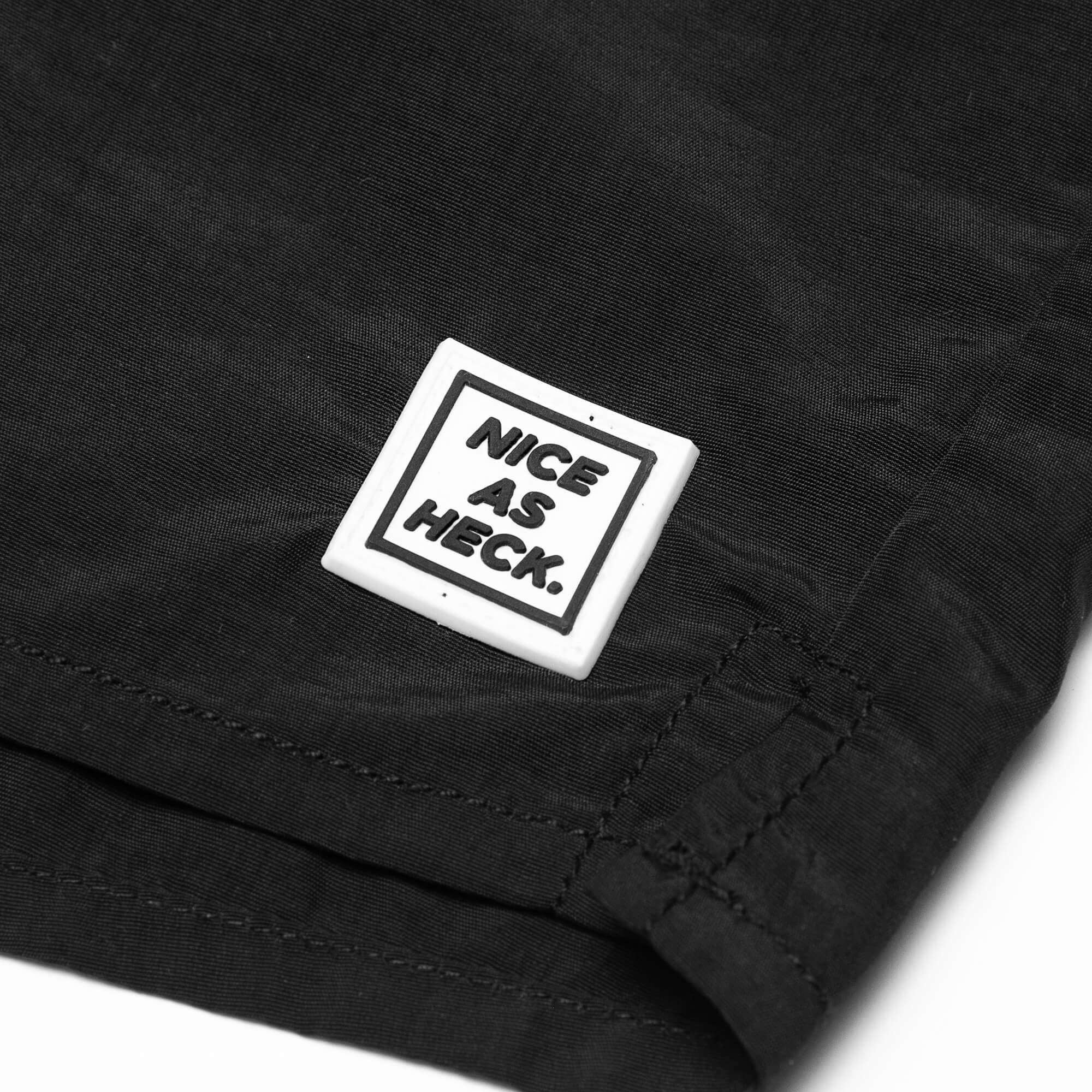 close up of the nice as heck logo on the twilight nylon shorts