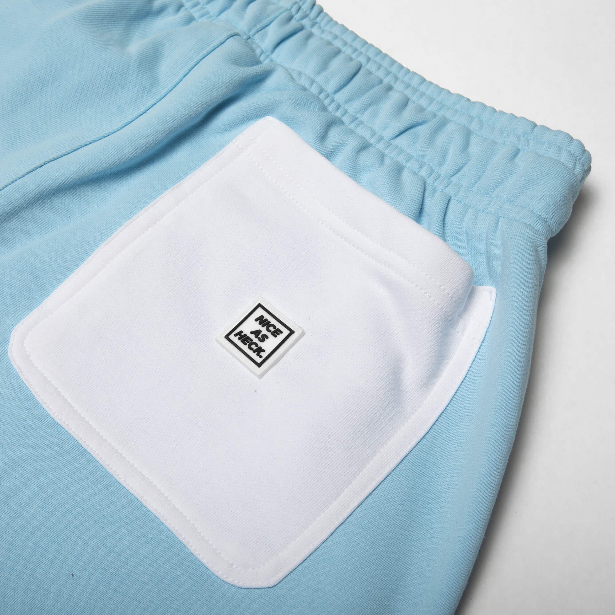 Close up view of the white back pocket on the Sunday sweats