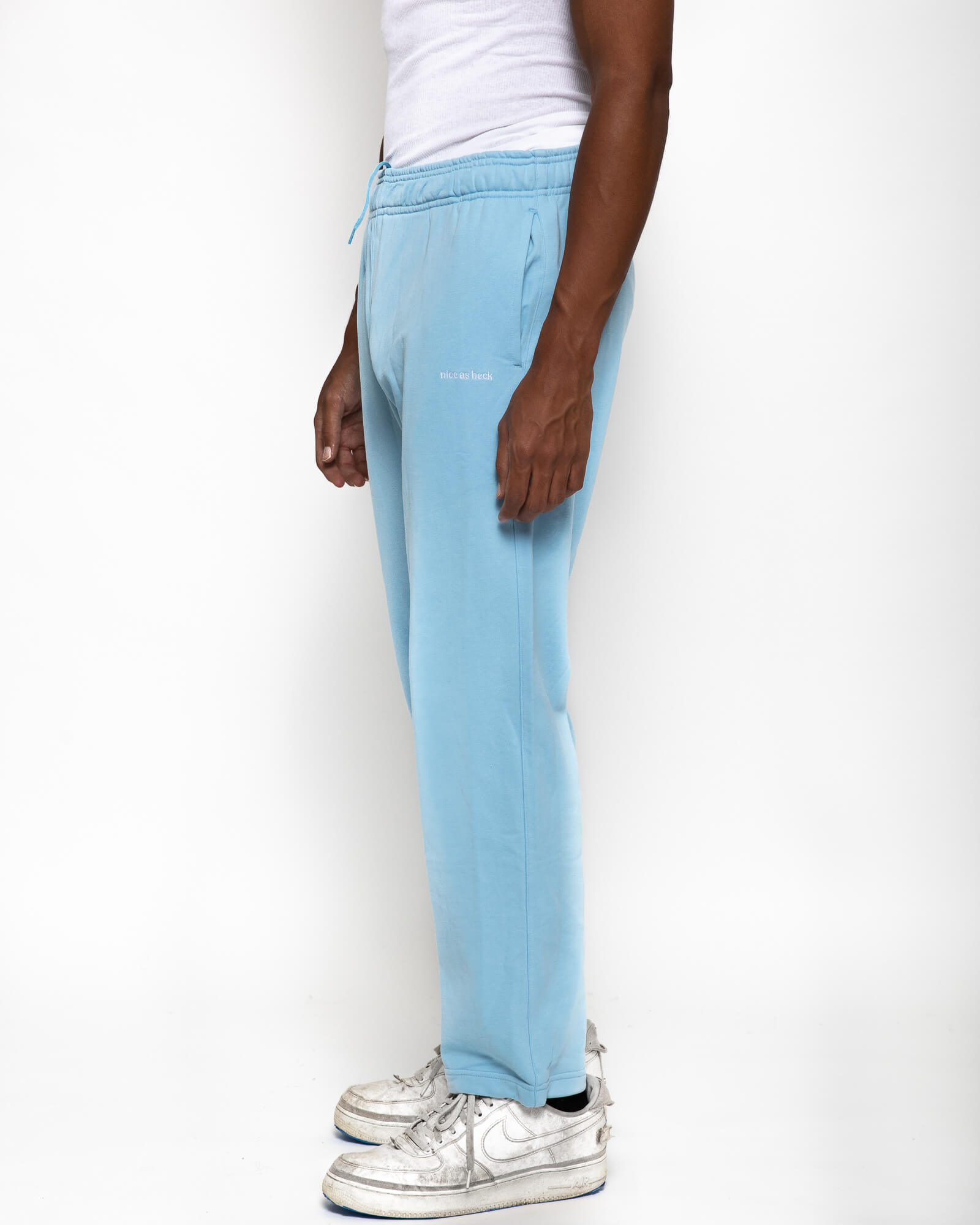 side view of male model wearing the blue sunday sweats