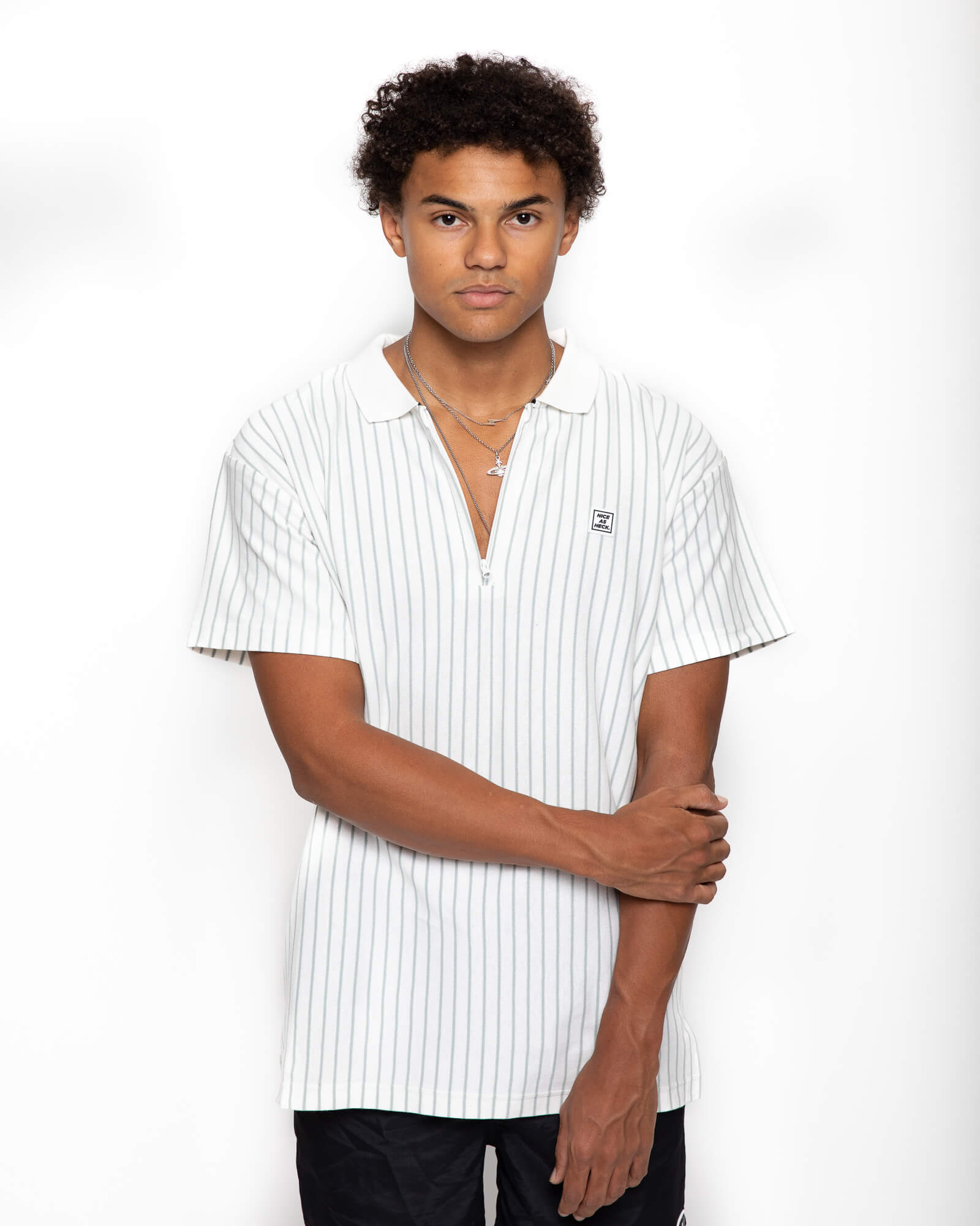 male model holding arm wearing the d plus polo