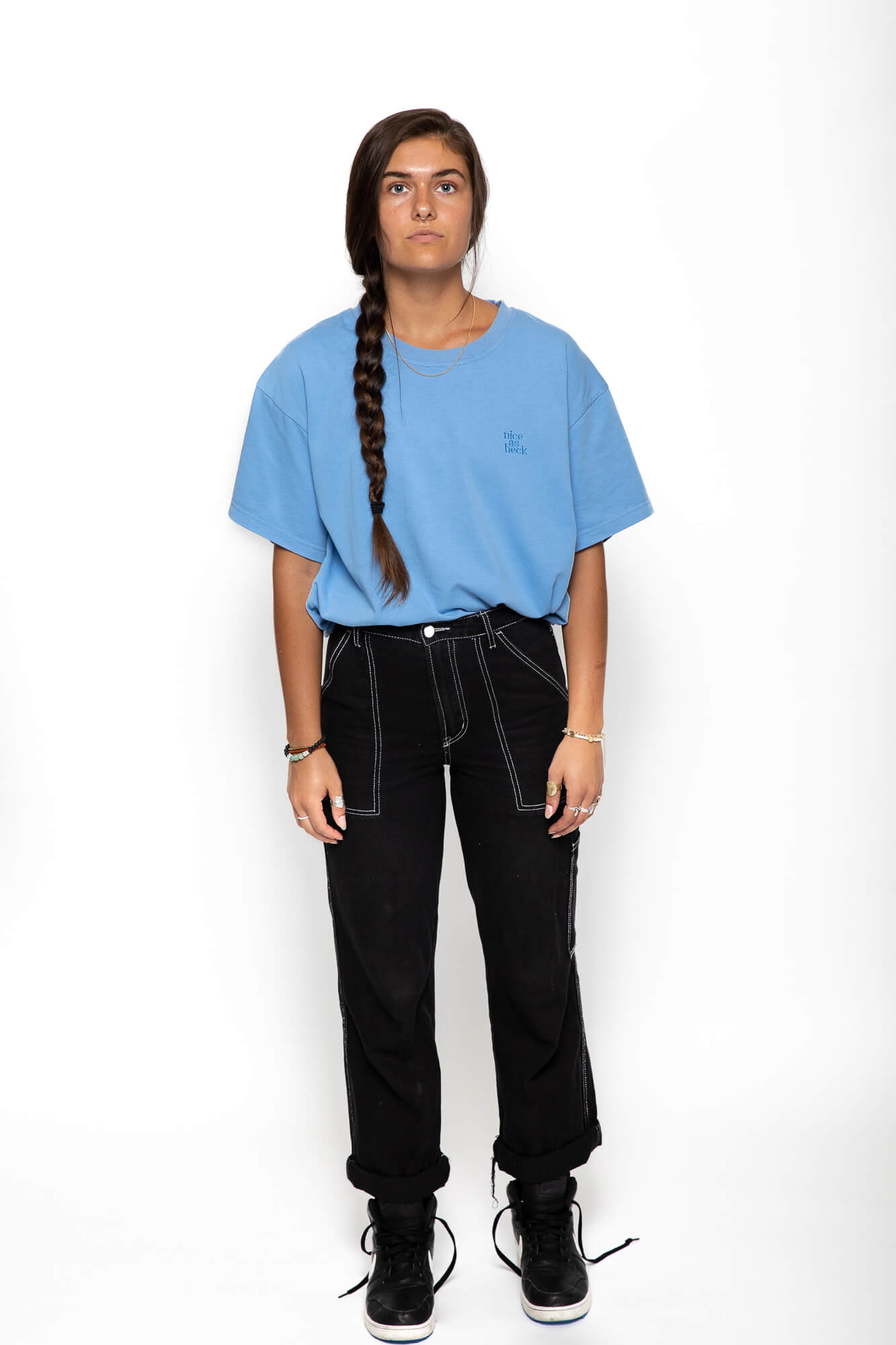 female model wearing the blue weekender tee with her arms by her side