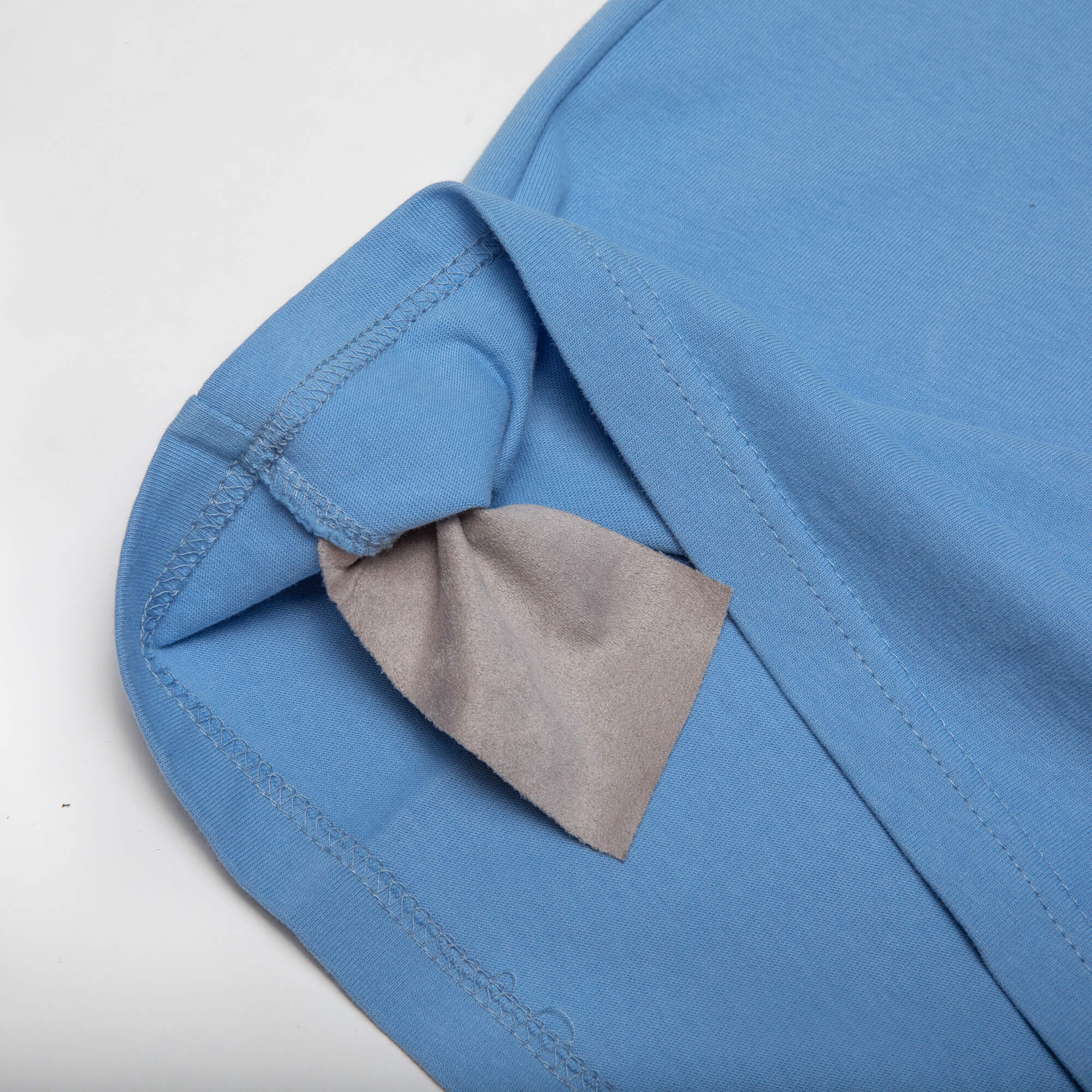 close up of the side of the blue weekender tee