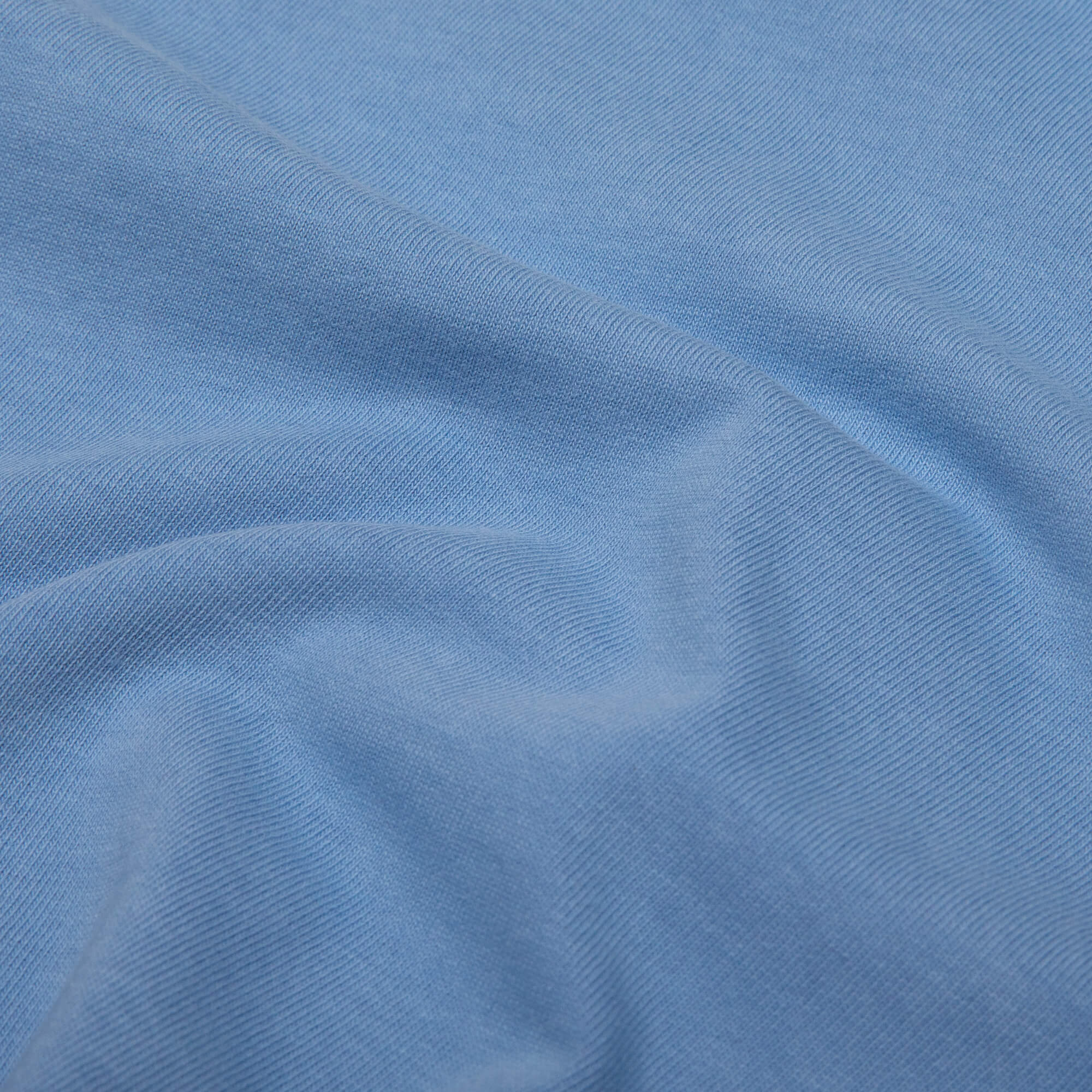 close up shot of the fabric of the blue weekender tee