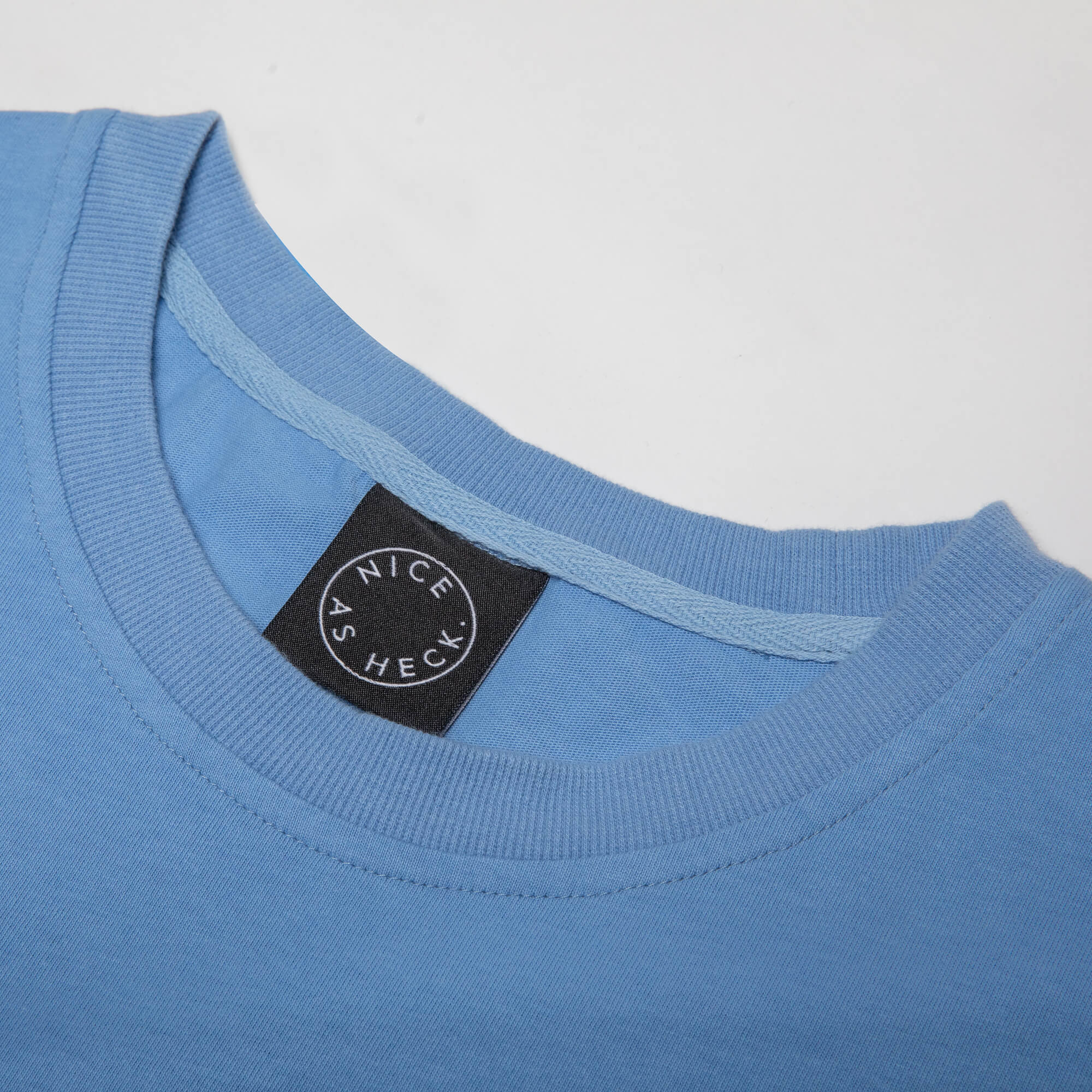 close up of the neck of the blue weekender tee