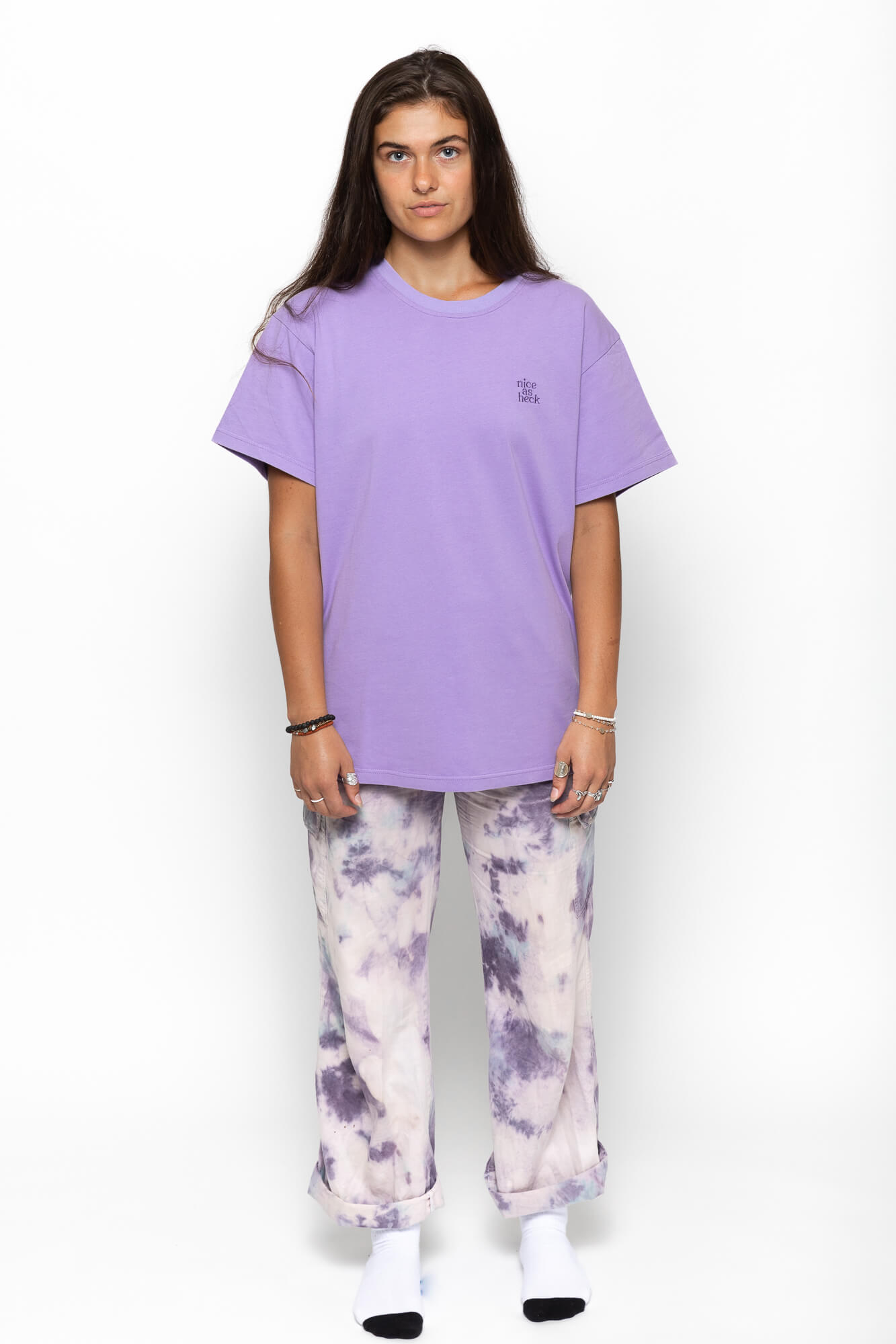 "5'8"" female model wearing purple weekender tee and purple tye dye pants"