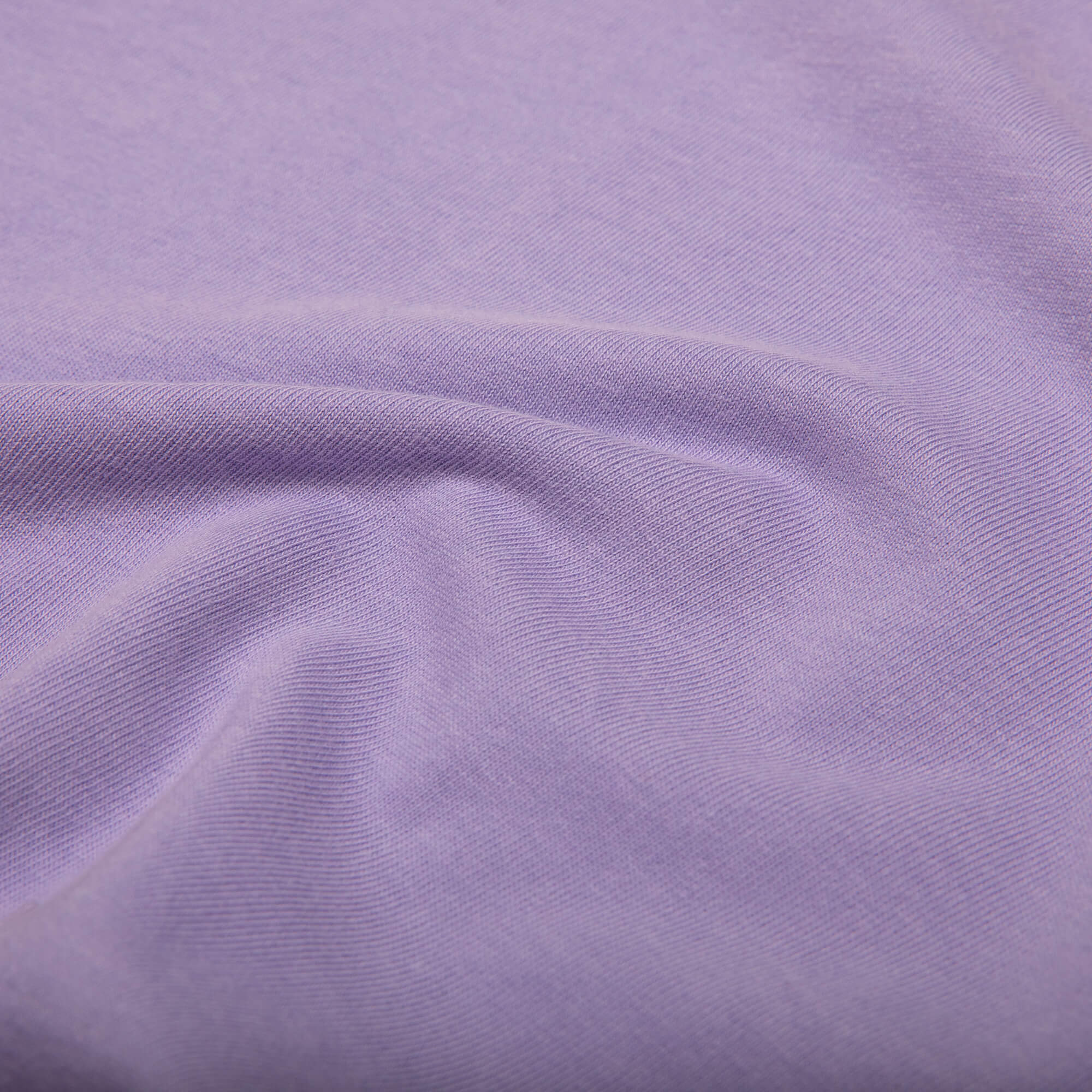close up of the fabric of the purple weekender tee