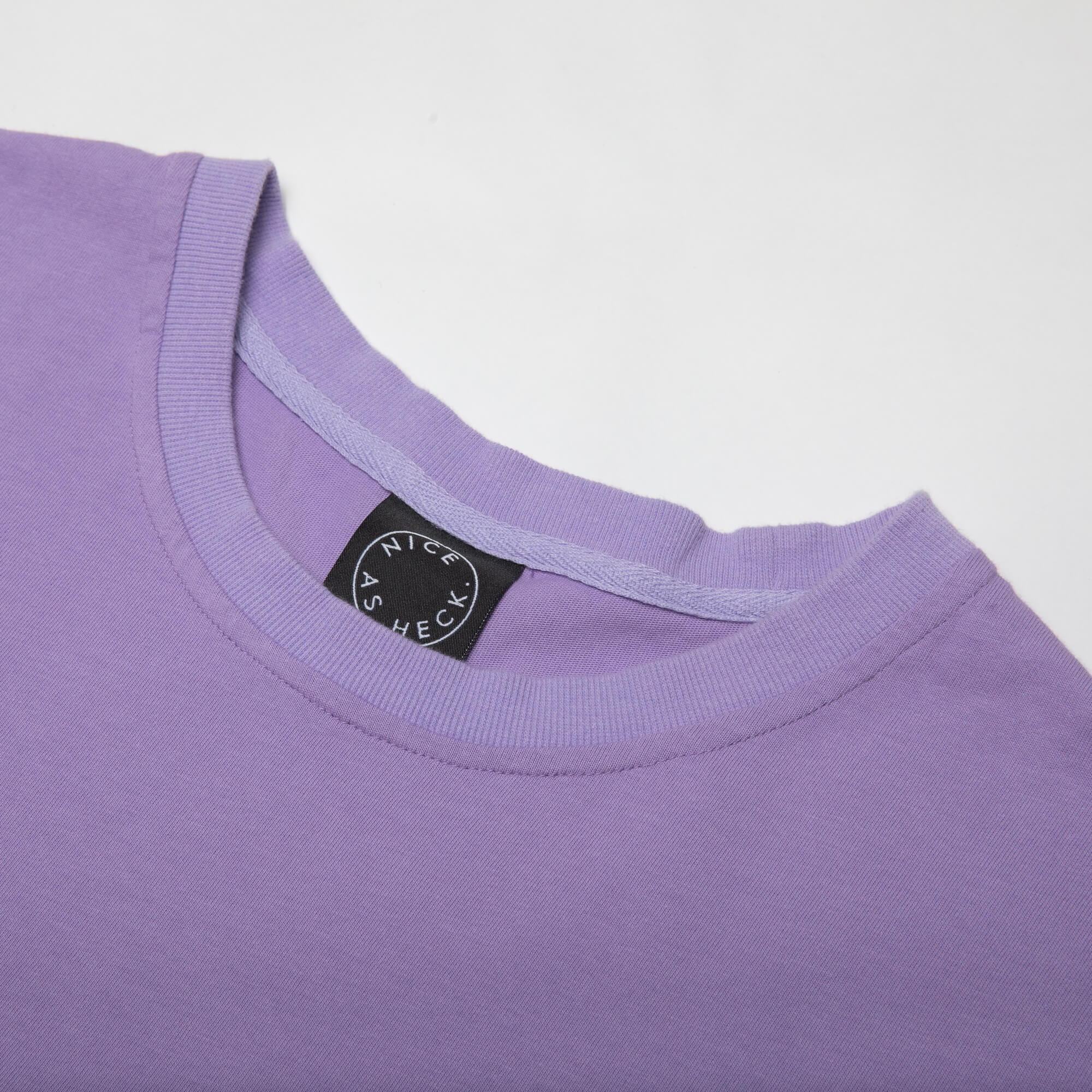close up photo of the neck of the purple weekender tee