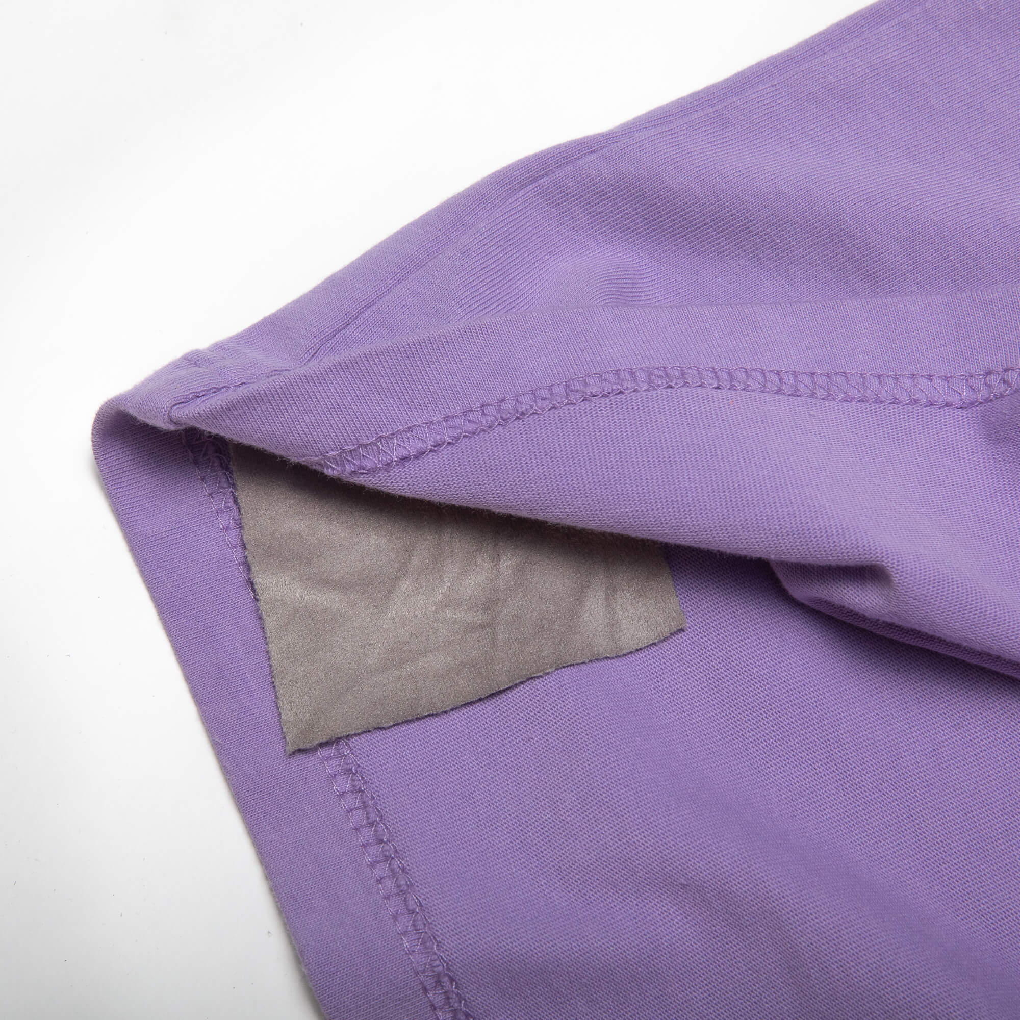 close up of the side of purple weekender tee
