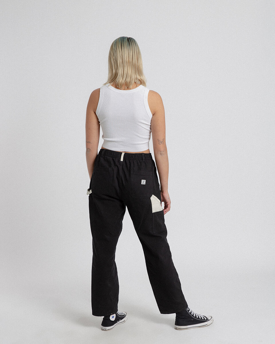 female model wearing cross country carpenter pants from the back