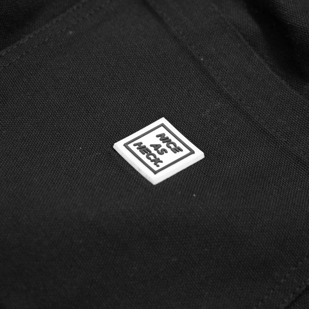 close up photo of the backside on the black cross country carpenter pants