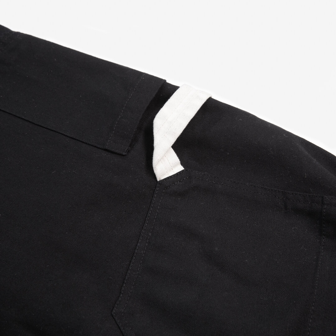 close up photo of the cuffs on the black cross country carpenter pants