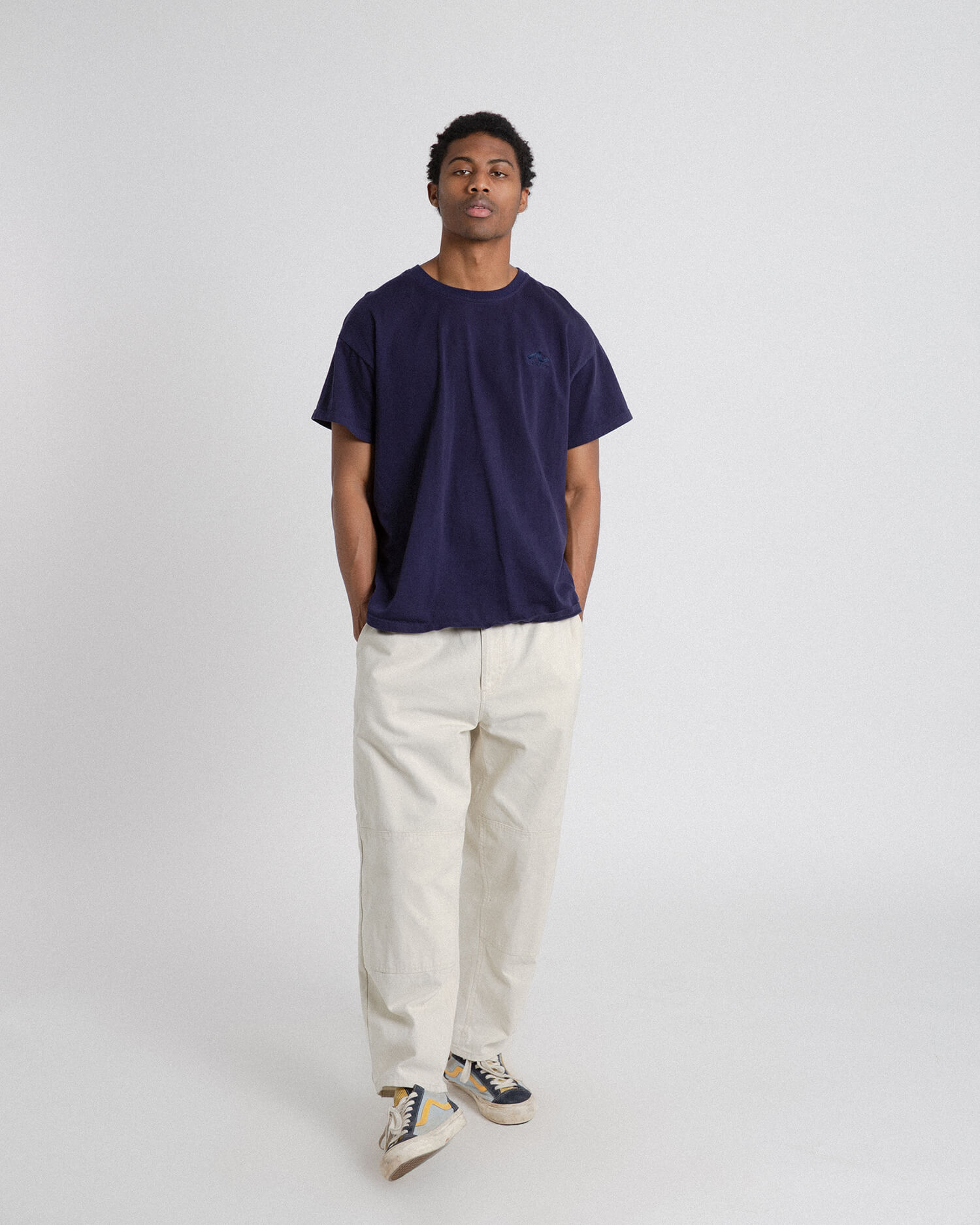 male model front view wearing off white cross country carpenter pants with hands in pockets