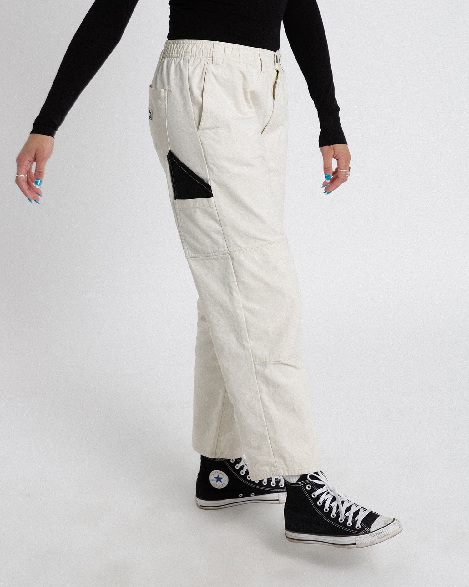 Female model wearing off white cross country carpenter pants
