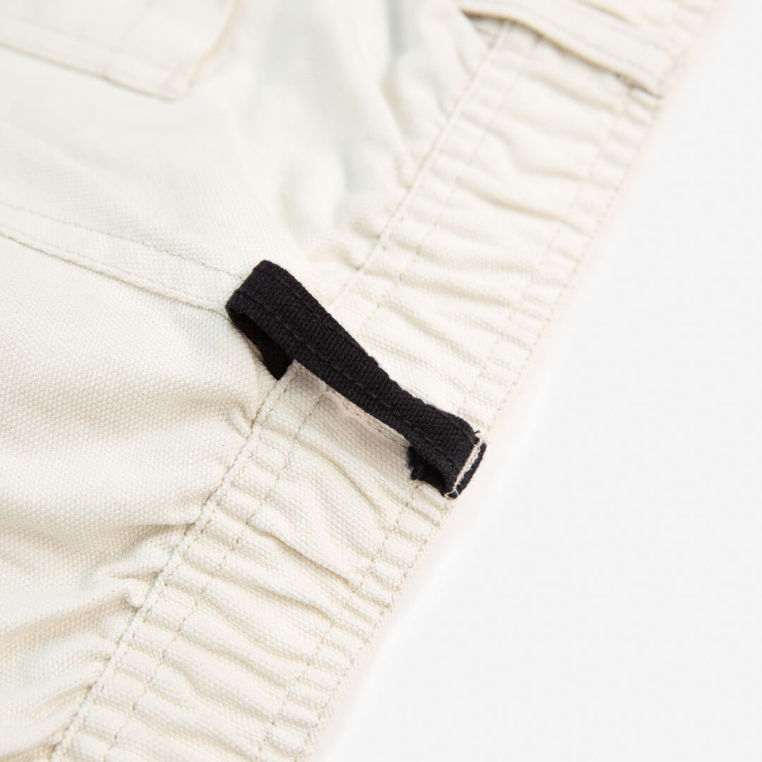 close up view of waitsline on off white cross country carpenter pants
