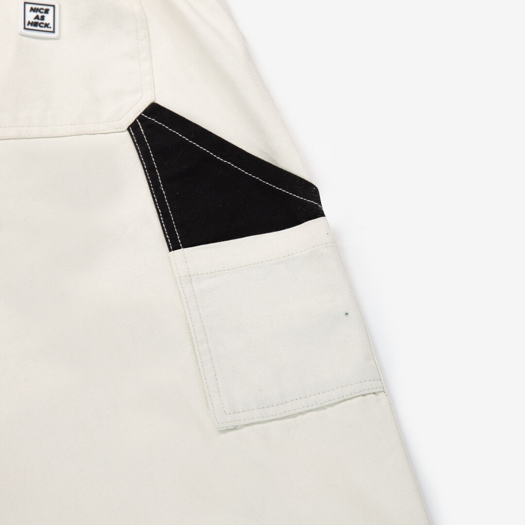 close up view of side pocket on off white cross country carpenter pants