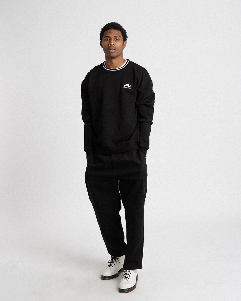 male model wearing black campfire crewneck front view