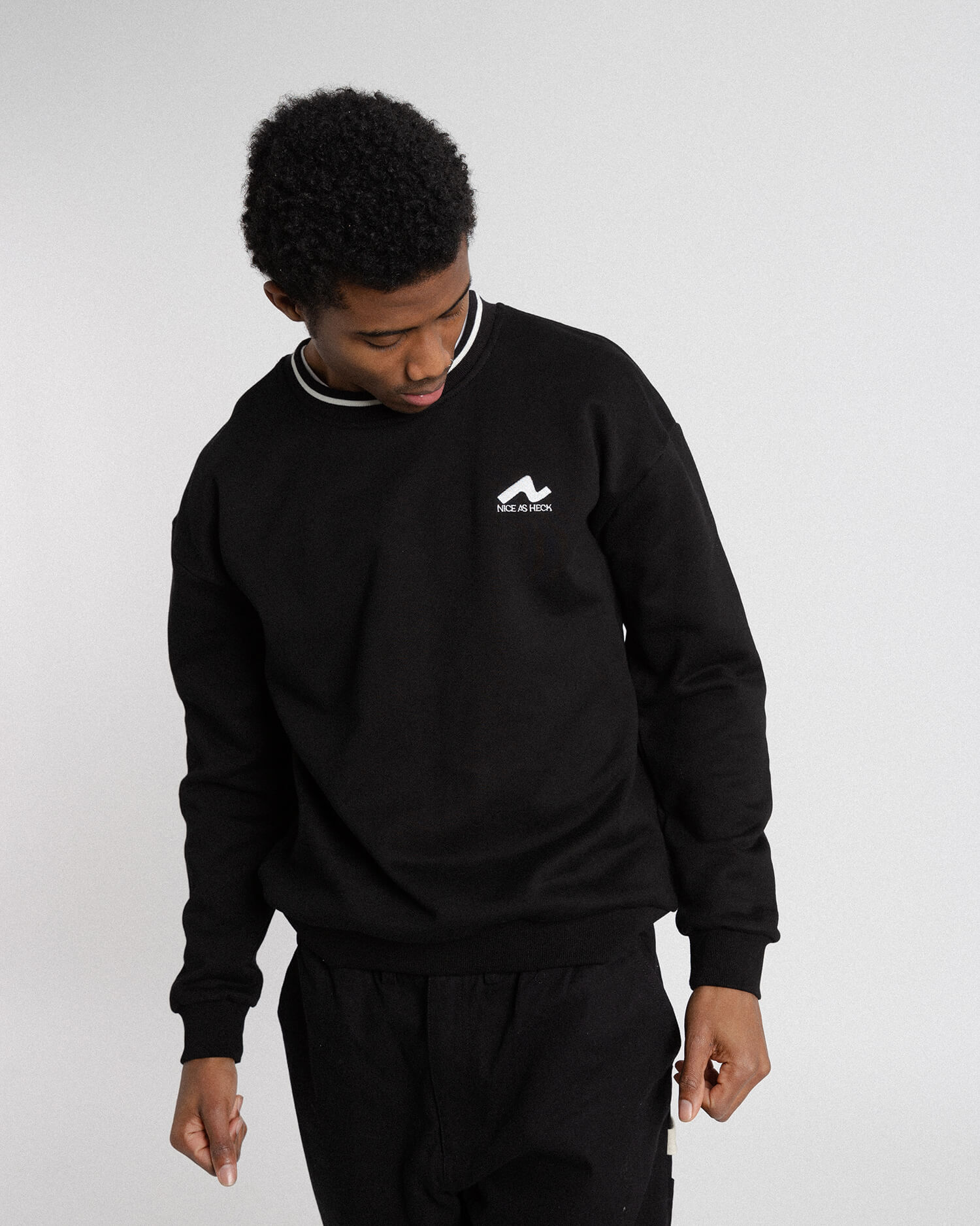 male model wearing the black campfire crewneck front view