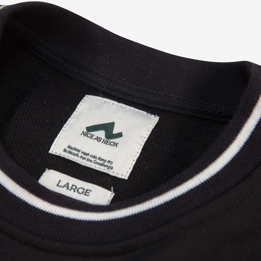 close up photo of the black campfire crewneck logo and neckline