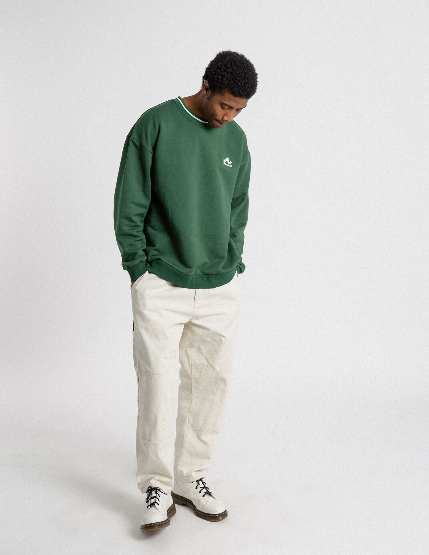 male model front view of green campfire crewneck
