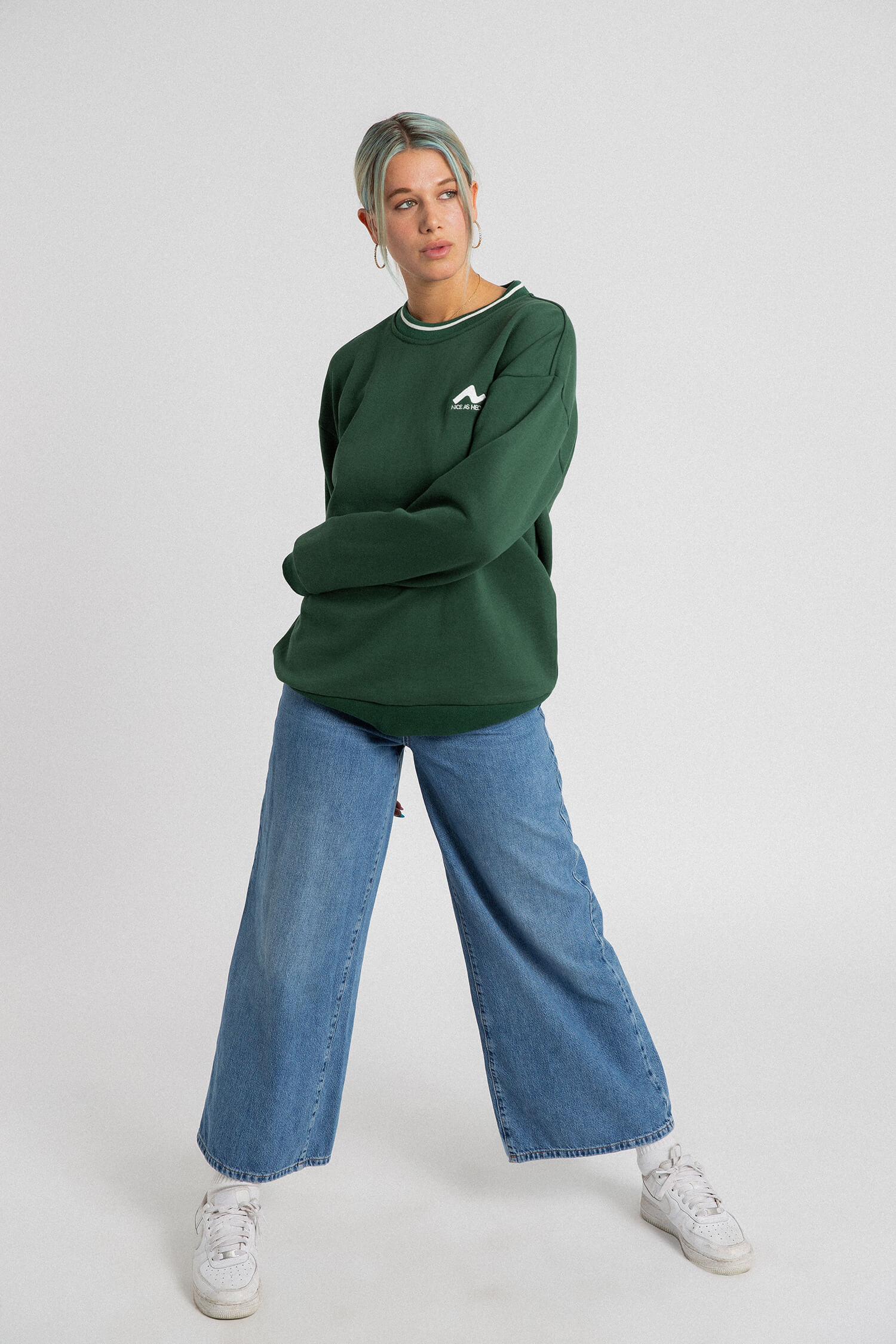female model front view for green campfire crewneck