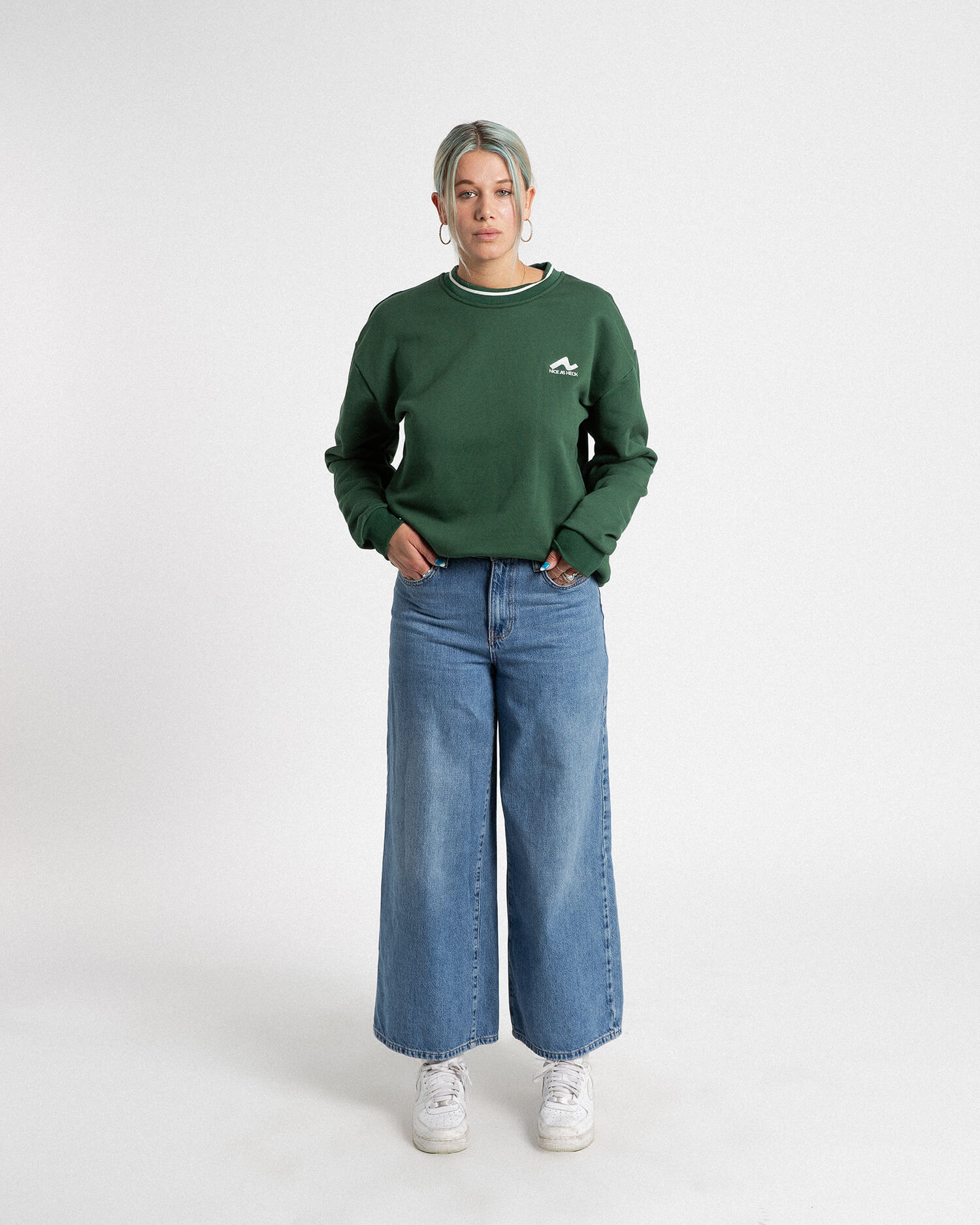 female model front view of green campfire crewneck