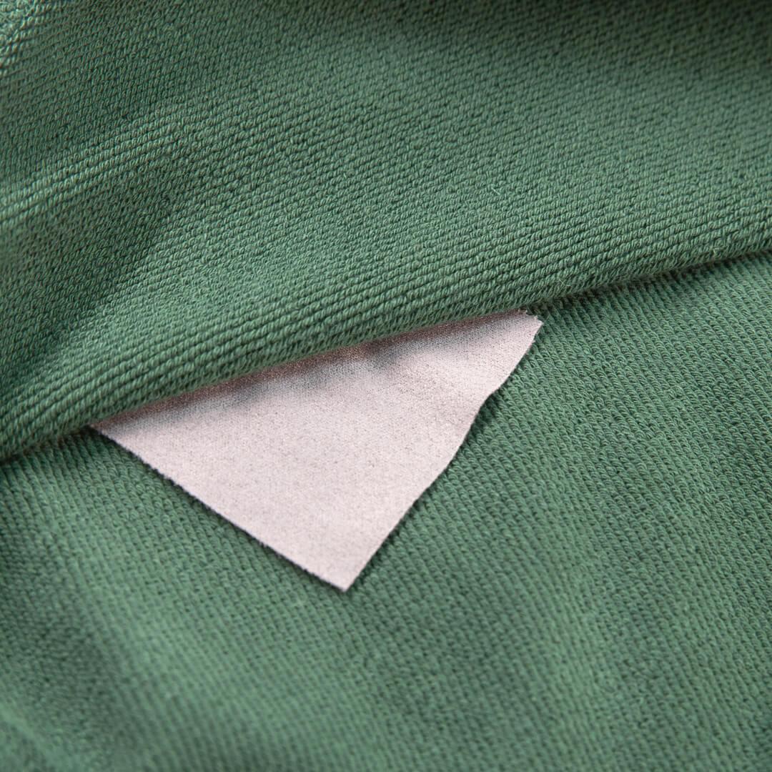 close up view of the green campfire crewneck neckline