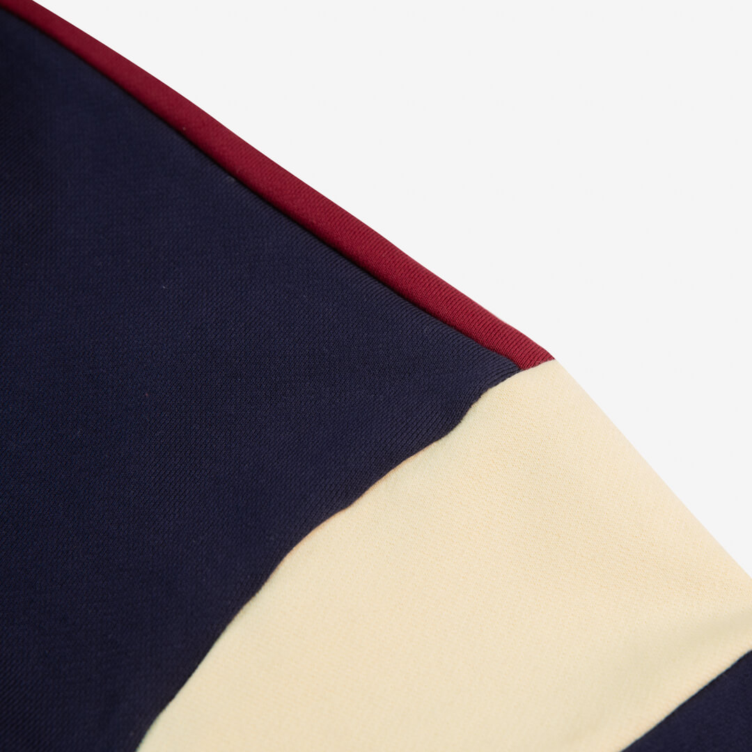 close up view of the navy campfire crewneck stipe on arm