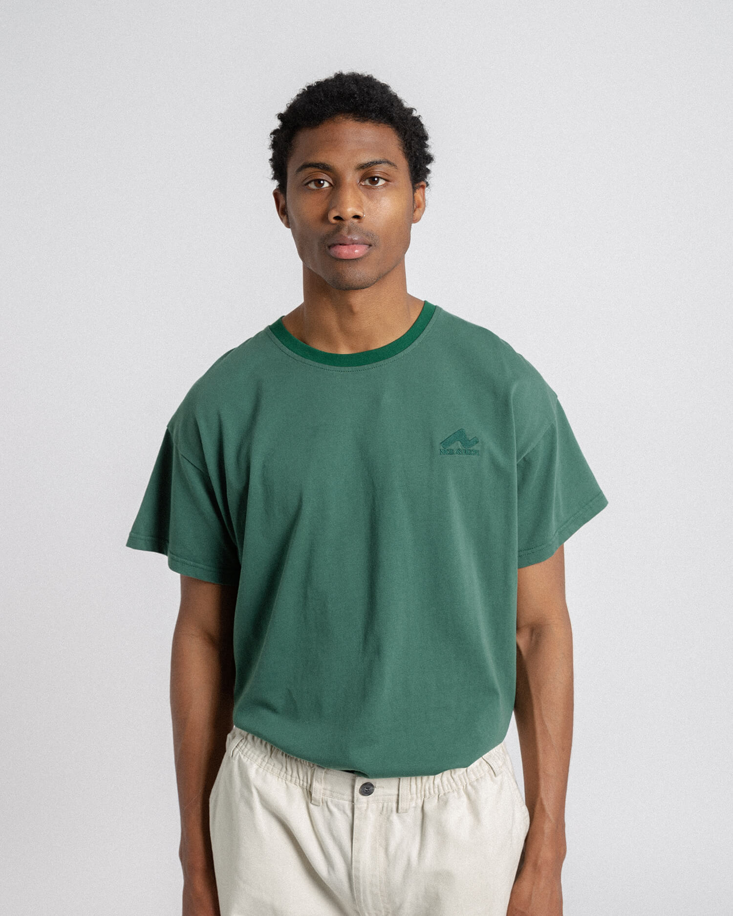 male model front view of green weekender tee