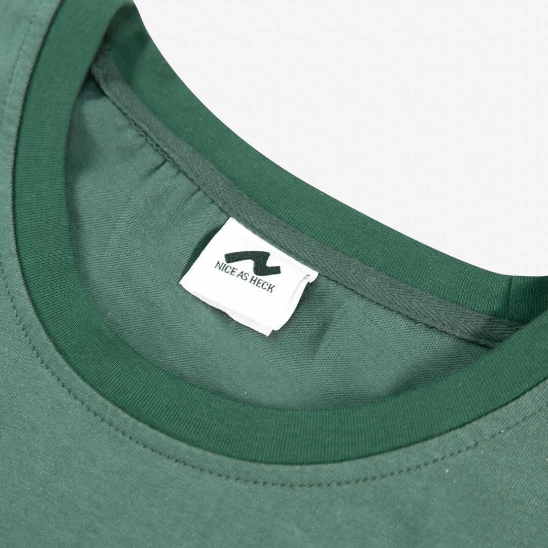 close up of the tag and neckline for the green weekender tee