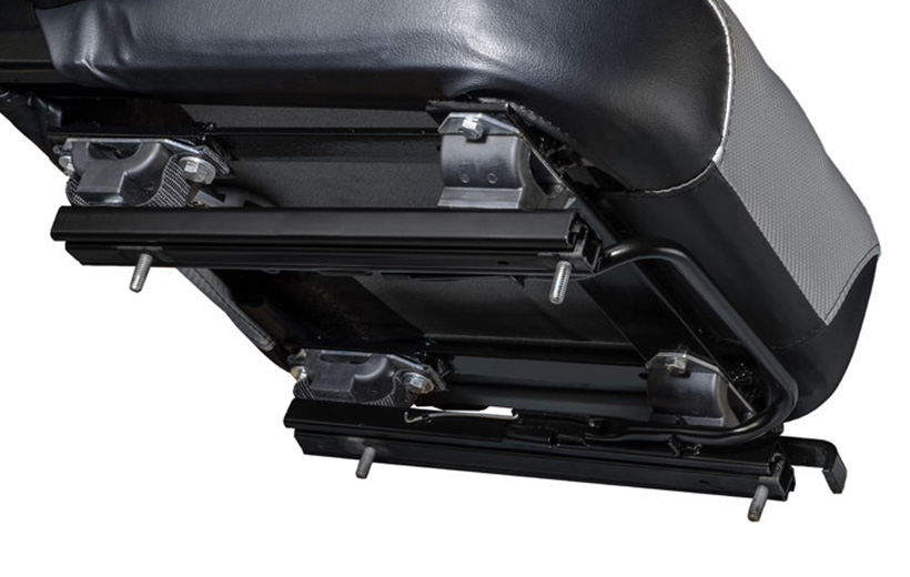 Image of the underside of a mower seat showing a set of rails with offset stands between the seat and rails