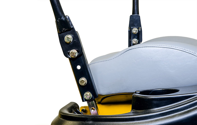 Image of black metal extension added on steering bar of mower