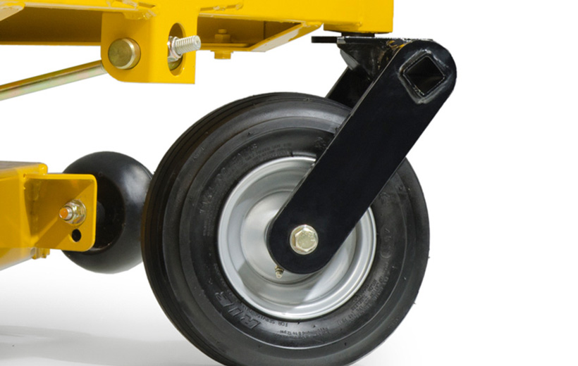 Image of a black front fork with the front tire mounted on a yellow mower