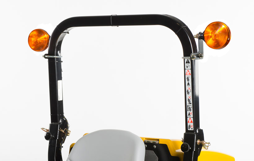 Image of the roll over bar of a mower with 2 orange lights mounted on either side.