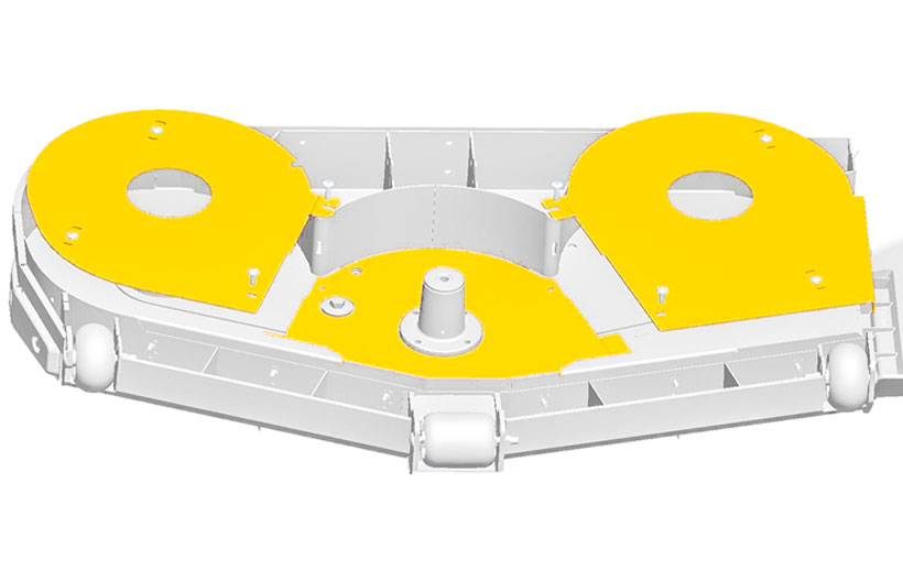 Image of the underside of a mower deck with the sand kit shown in yellow mounted under the deck spindles.